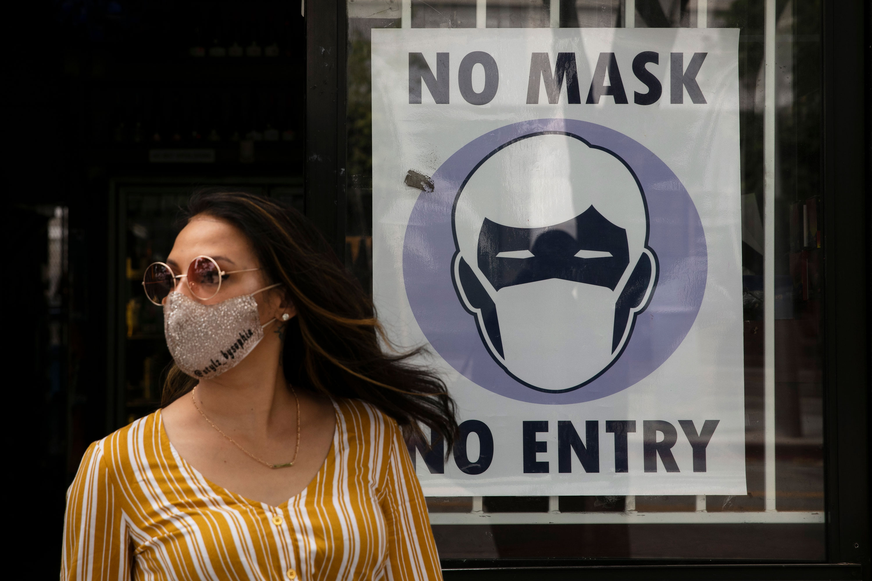 A woman walks out of a store in Santa Monica, California, on June 23.