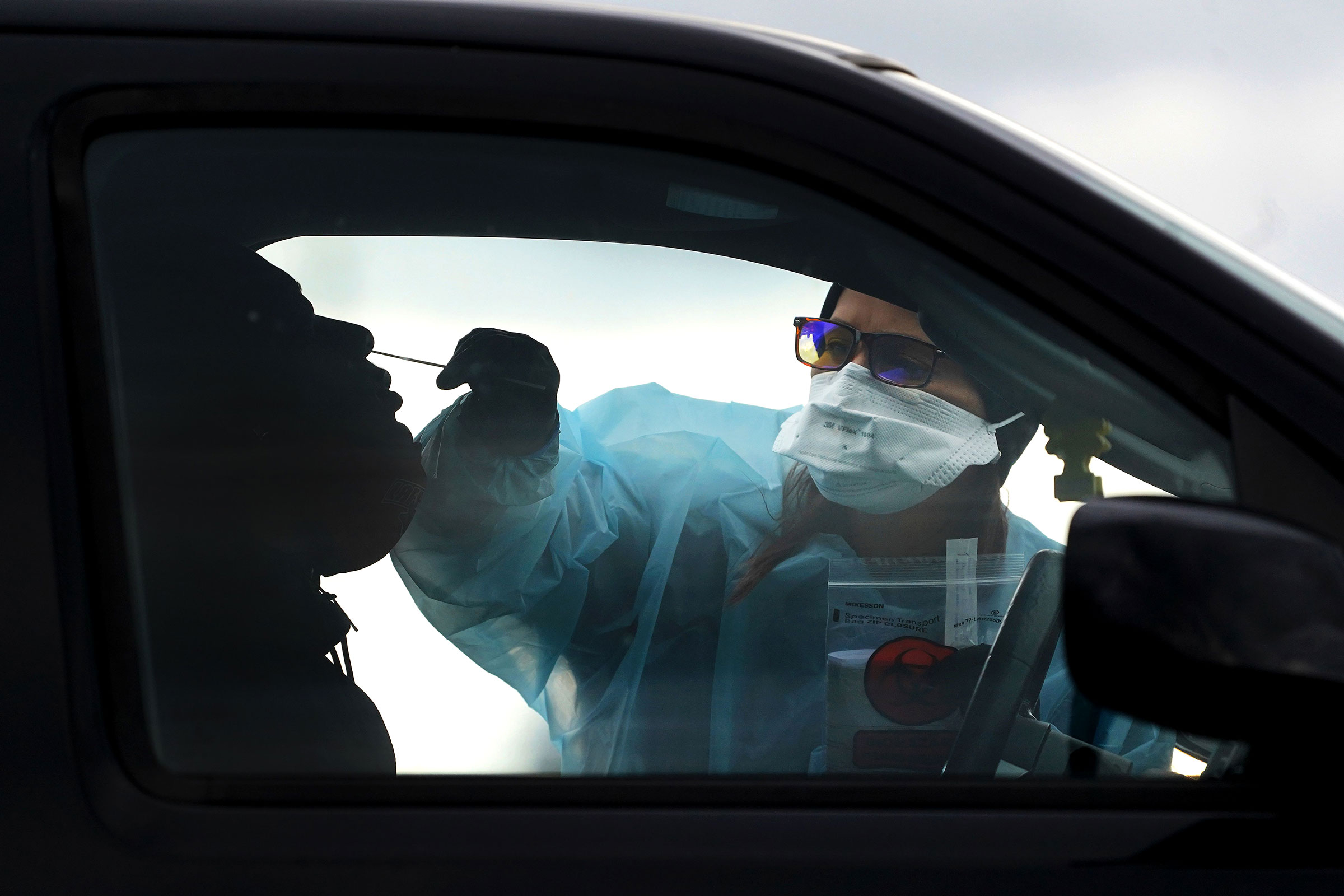 A healthcare worker administers a Covid-19 test at the William Penn Highway Park & Ride on December 2 in Easton, Pennsylvania.