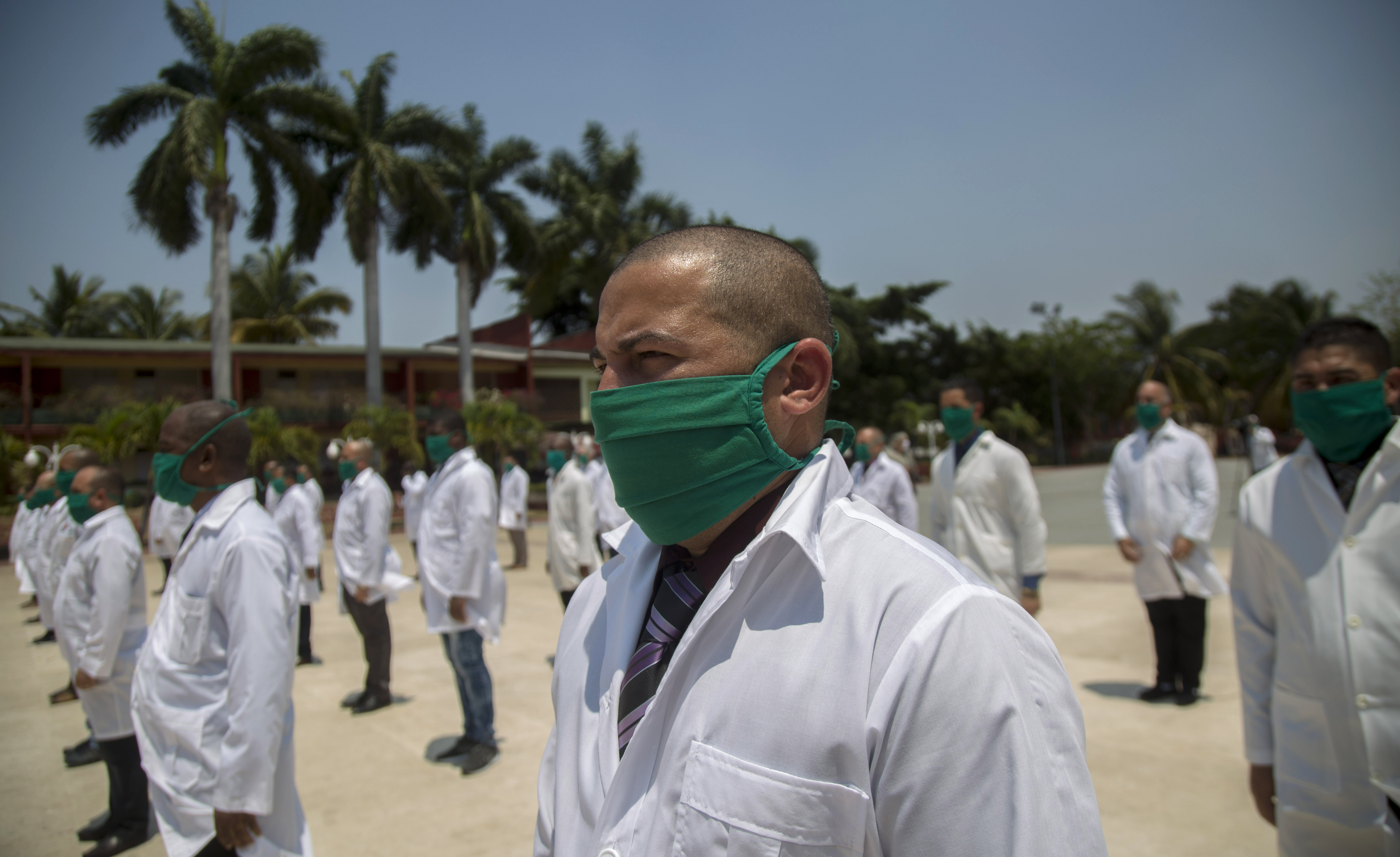 Cuban doctors attend a farewell ceremony in Havana, Cuba, on April 12 before leaving to help with the novel coronavirus outbreak in Italy.