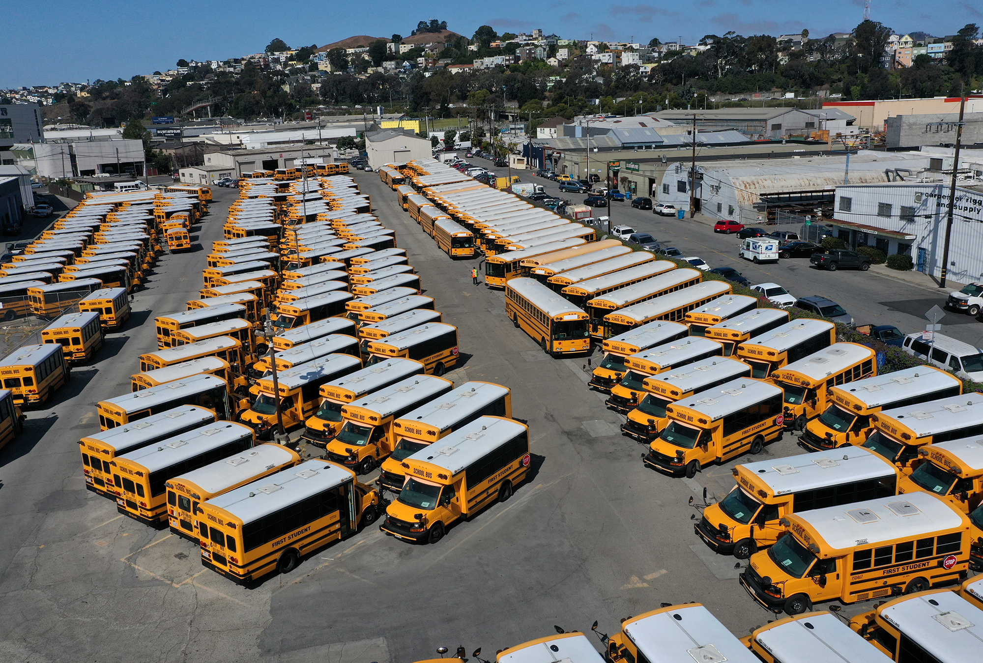 School buses sit parked in a lot at First Student Charter Bus Rental on July 14, 2020 in San Francisco, California.