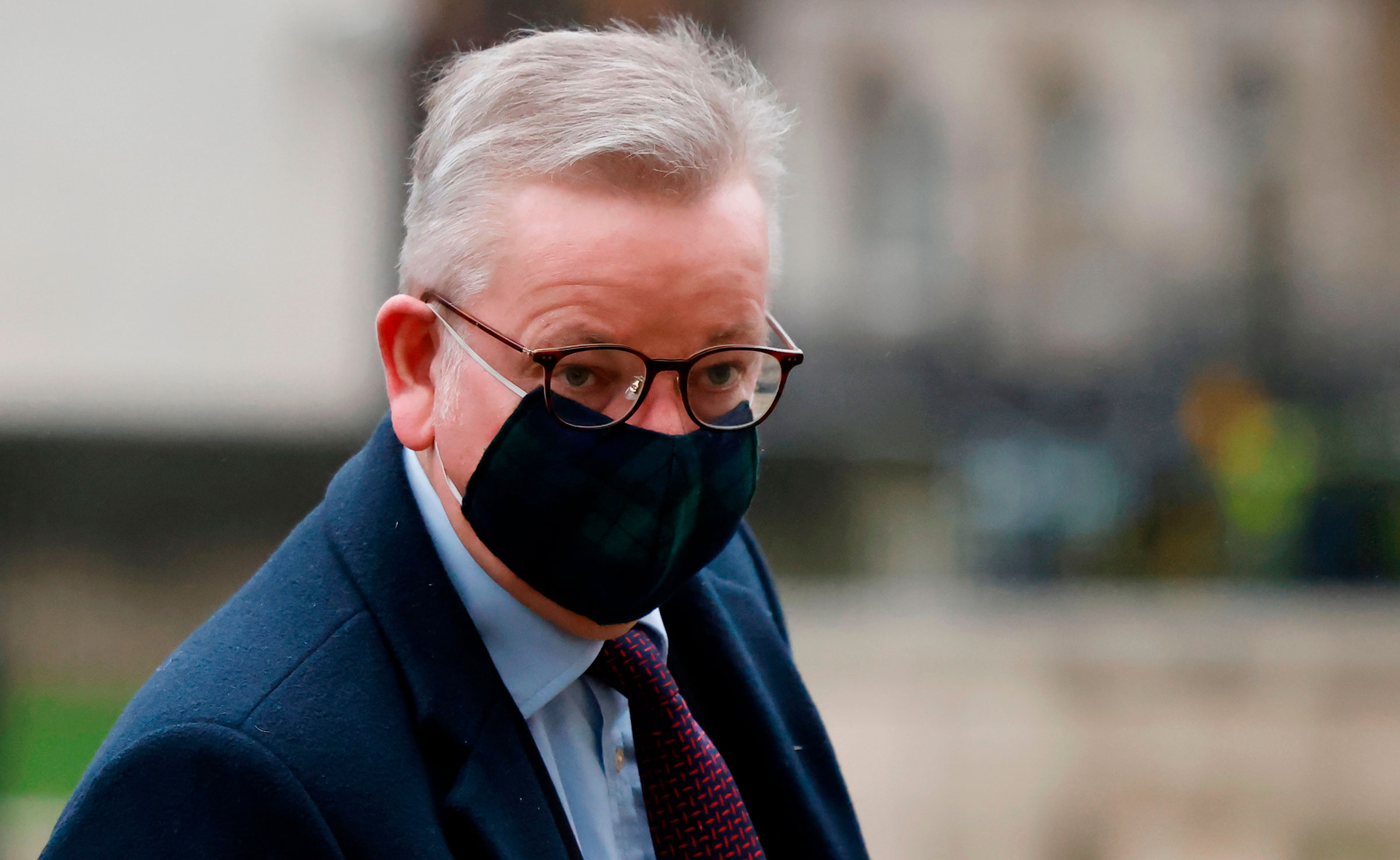 Cabinet Office Minister Michael Gove arrives at the Cabinet Office on December 21 in London.