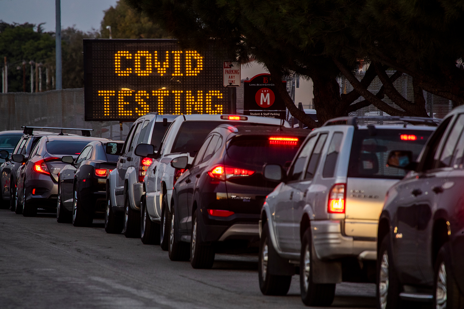 A long line of vehicles line up to take Covid-19 tests at Long Beach City College-Veterans Memorial Stadium in Long Beach, California, on December 9.