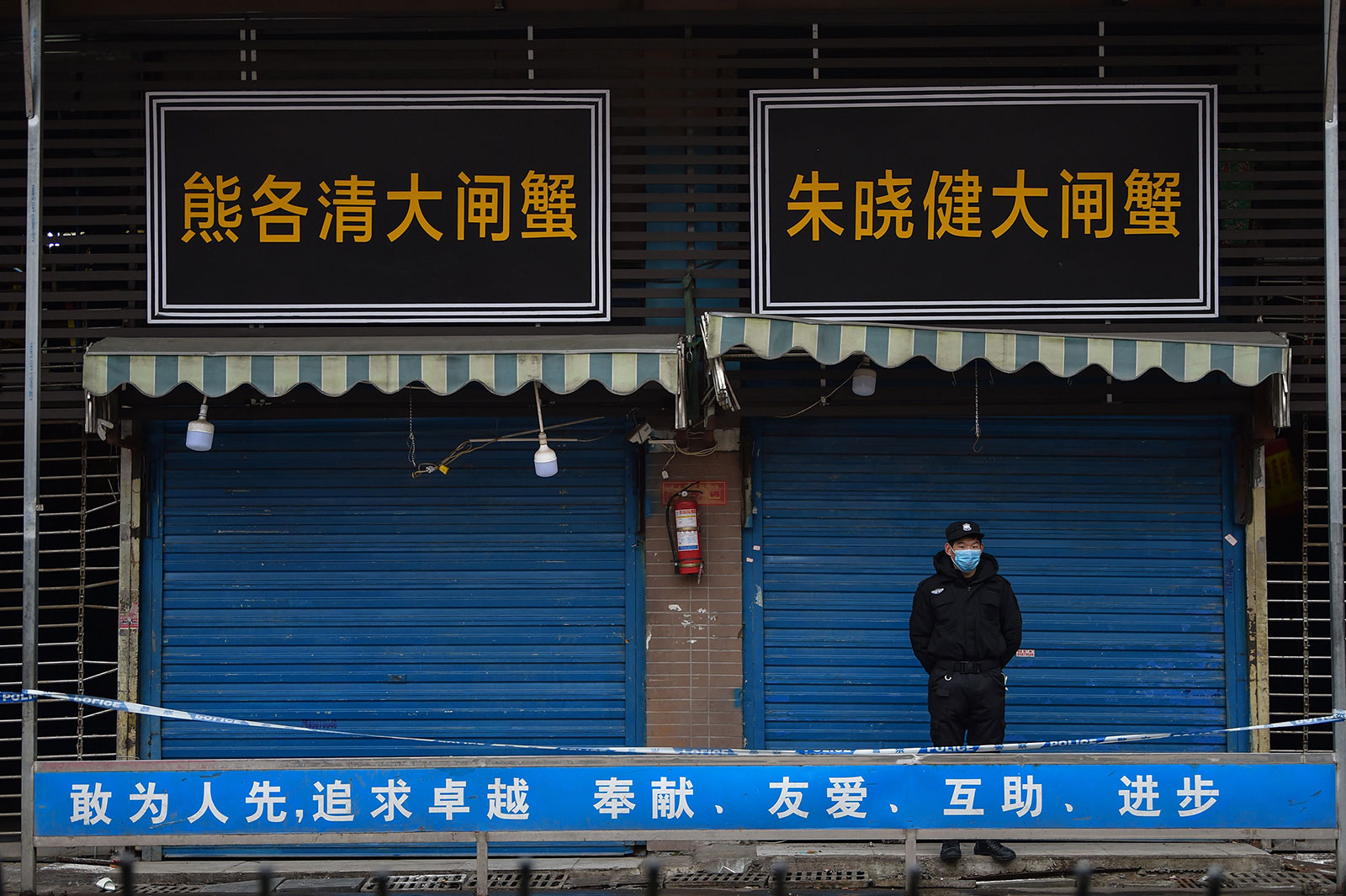 A security guard stands outside the Huanan Seafood Wholesale Market in Wuhan, China, on January 24.
