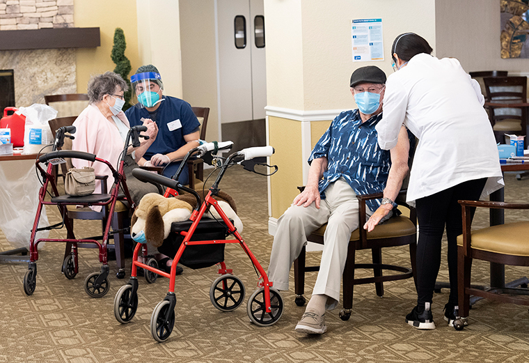 Residents get the Pfizer/BioNTech COVID-19 vaccine at the Emerald Court senior living community in Anaheim, California on Friday, January 8.