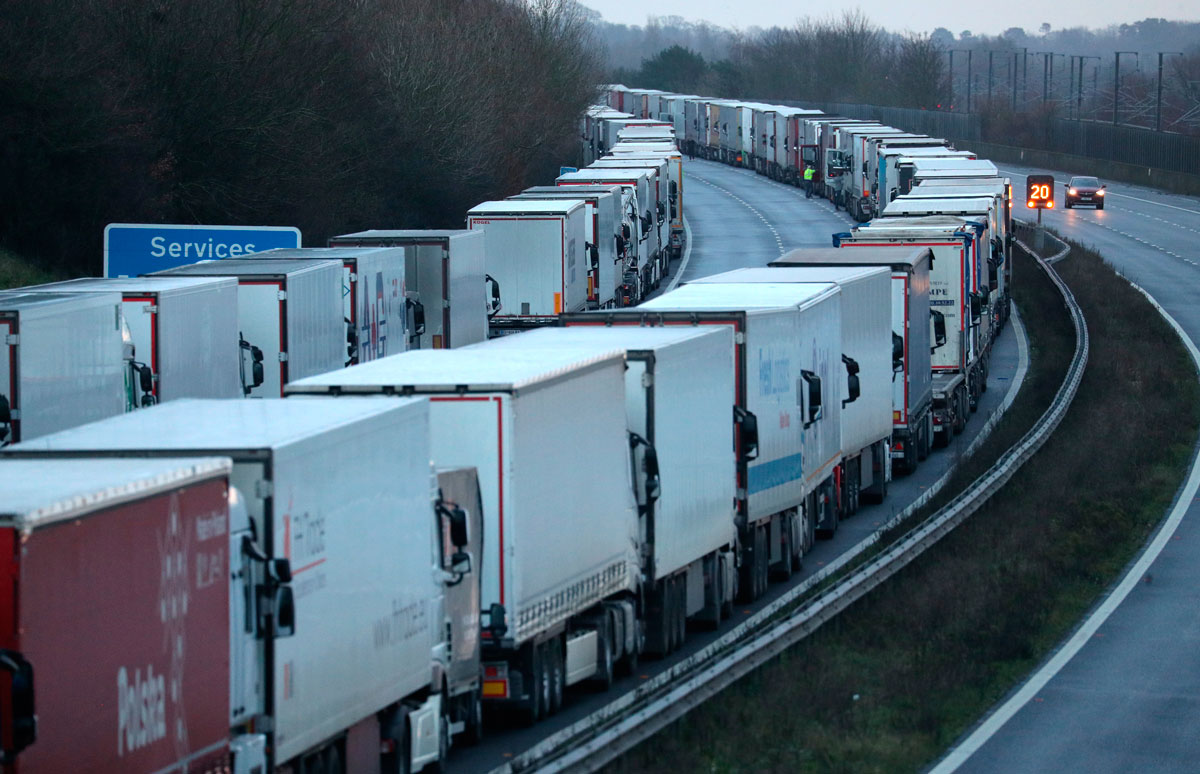 Lorries are parked along the M20 in Kent while the Port of Dover remains closed on December 22.