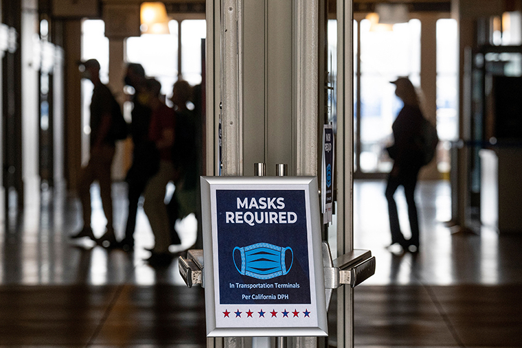 """A """"Masks Required"""" sign posted at the entrance to the Ferry Building in San Francisco, California, U.S., on Monday, July 19, 2021."""