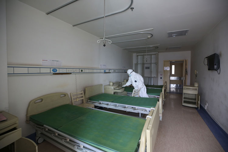 A worker disinfects a room at the Red Cross hospital in Wuhan, in China's central Hubei province on March 18.