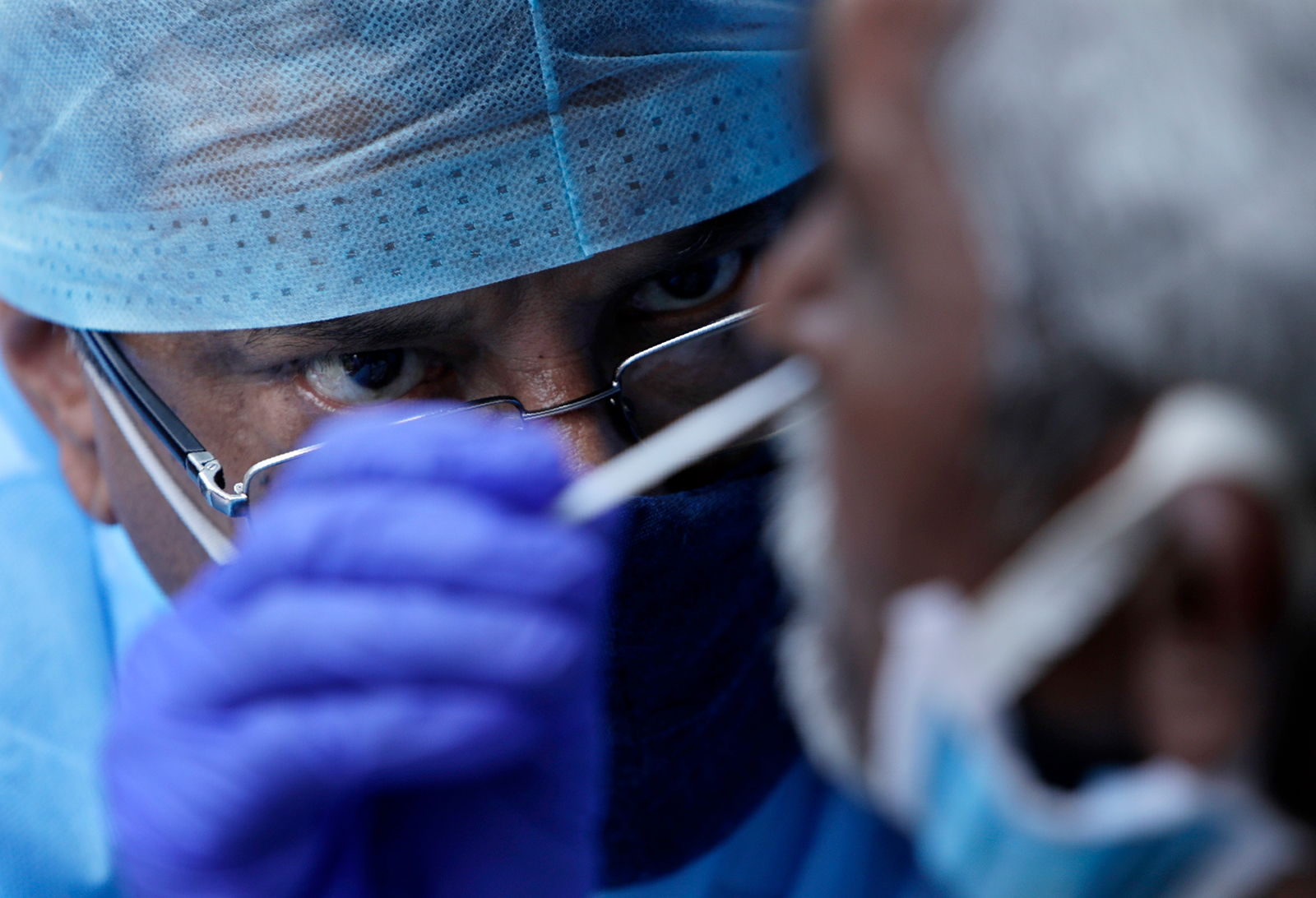 A health worker takes a nasal swab sample to test for Covid-19 at a market place in Mumbai, India, on March 18.