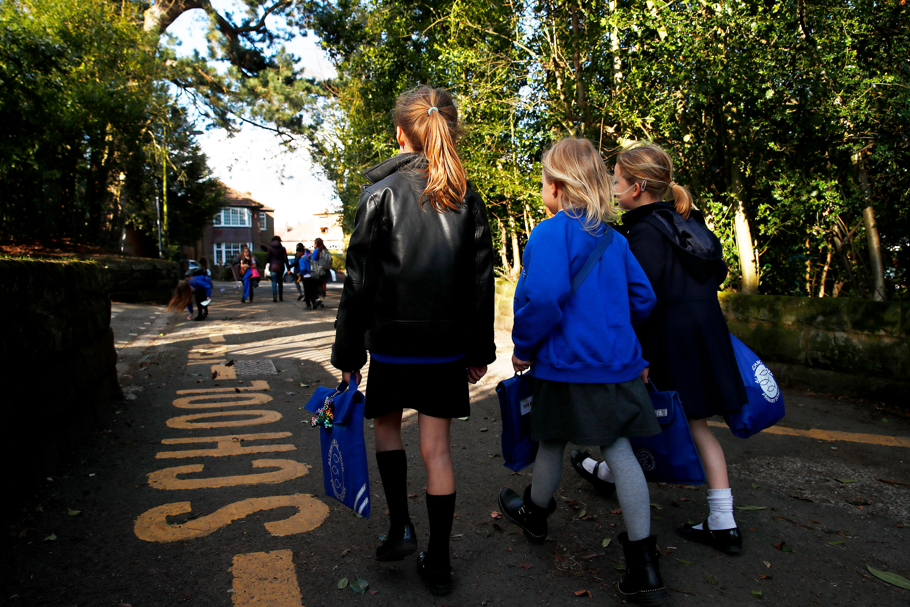 Children walk home from school in Altrincham, England, on March 20.