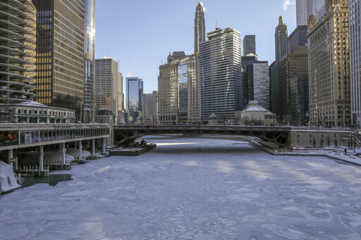 Ice covers the Chicago River on Wednesday in Chicago.