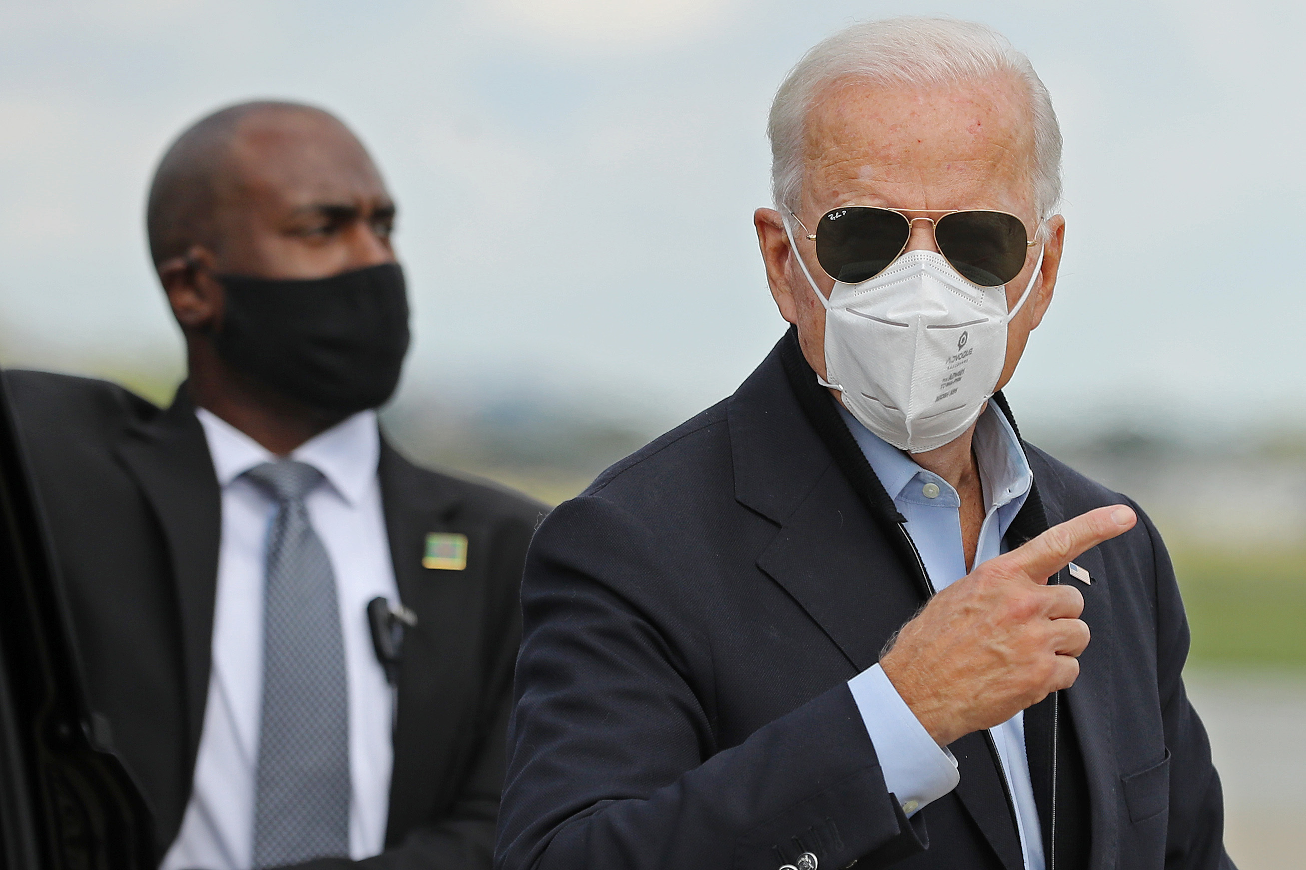 Democratic presidential nominee Joe Biden prepares to board a plane in New Castle, Delaware, on his way to Grand Rapids, Michigan, on October 2.