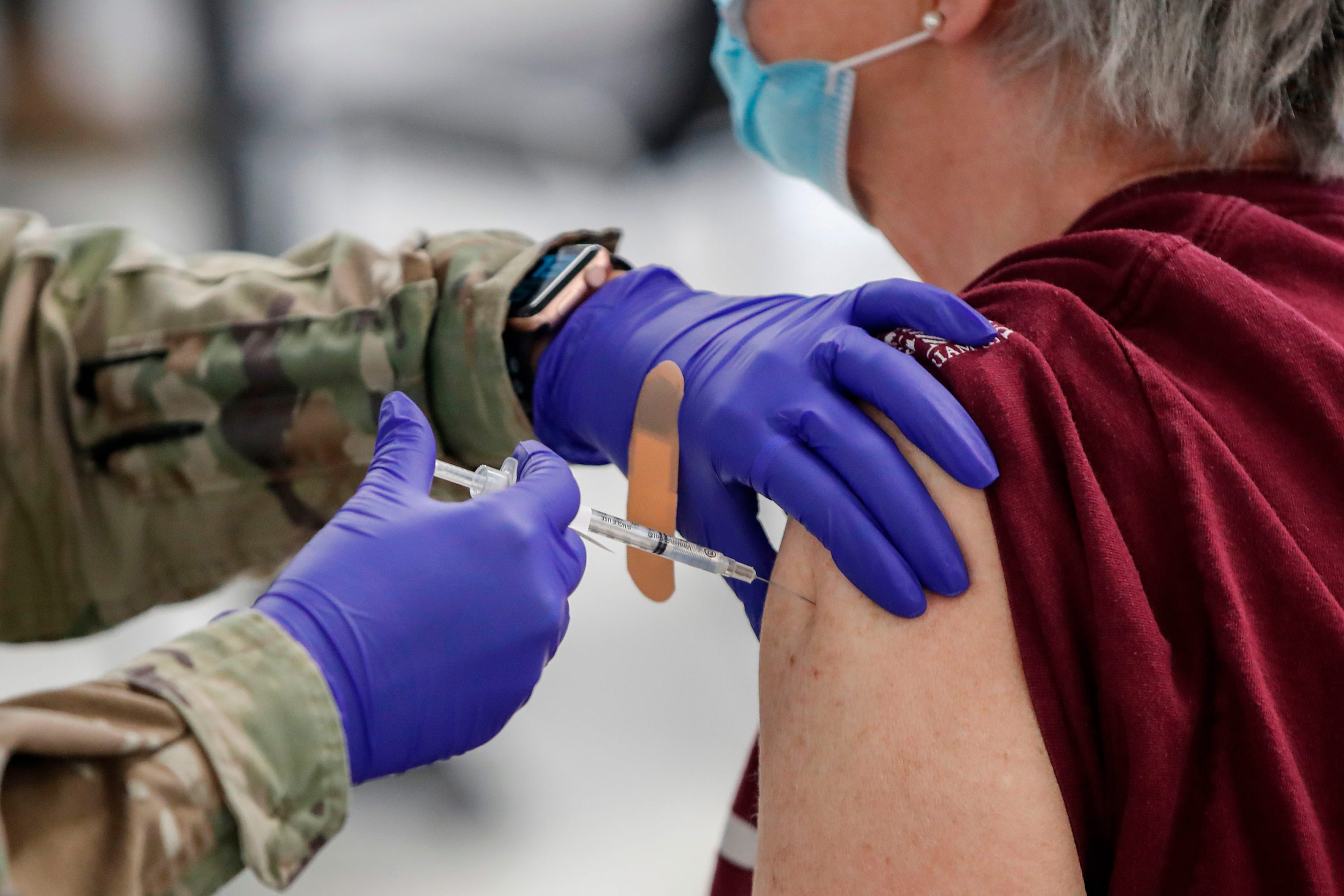 A woman receives a Pfizer Covid-19 vaccine at a vaccination center in River Grove, Illinois, on February 3.
