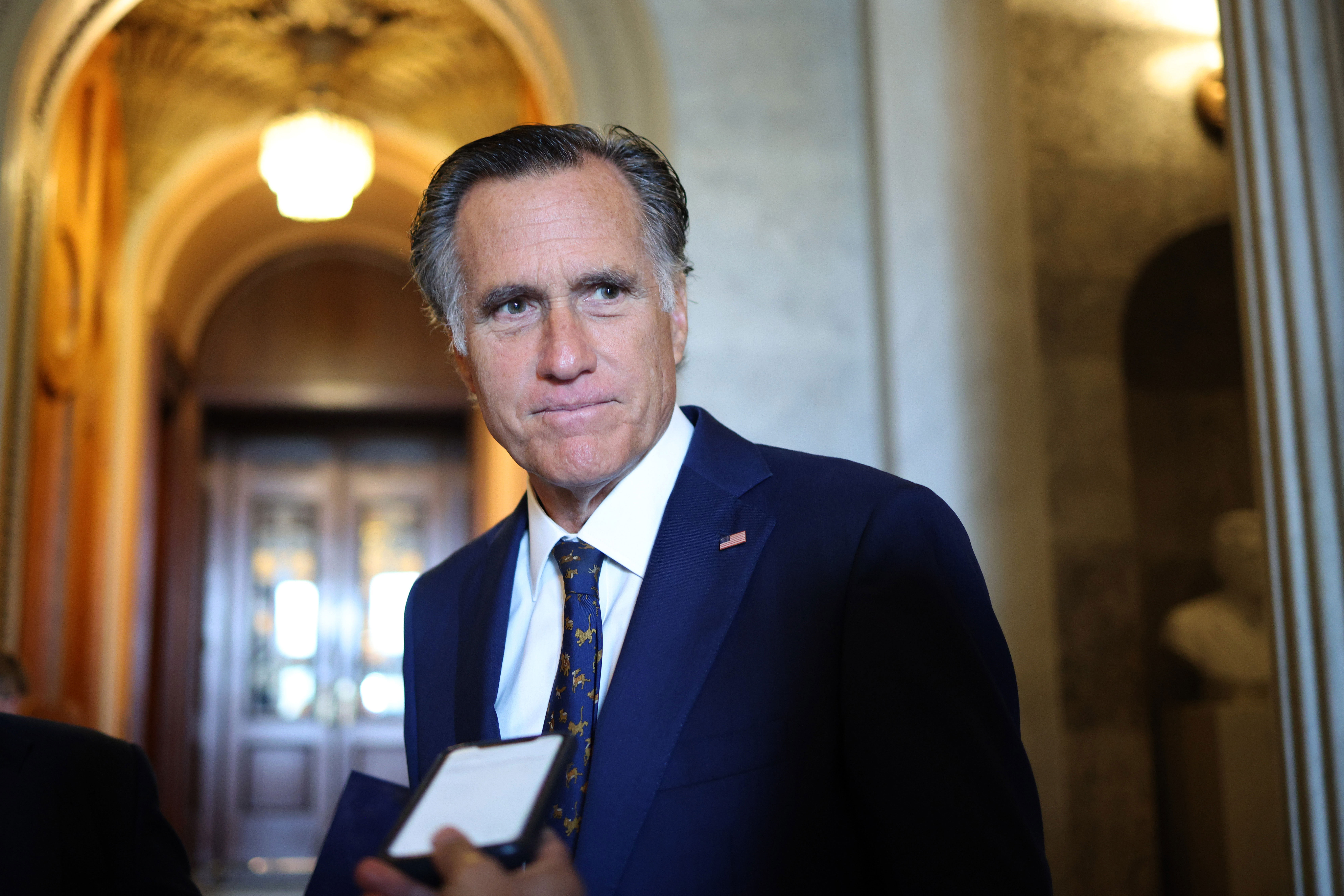 Sen. Mitt Romney speaks to reporters at the Capitol in Washington, DC, on July 21, 2021.