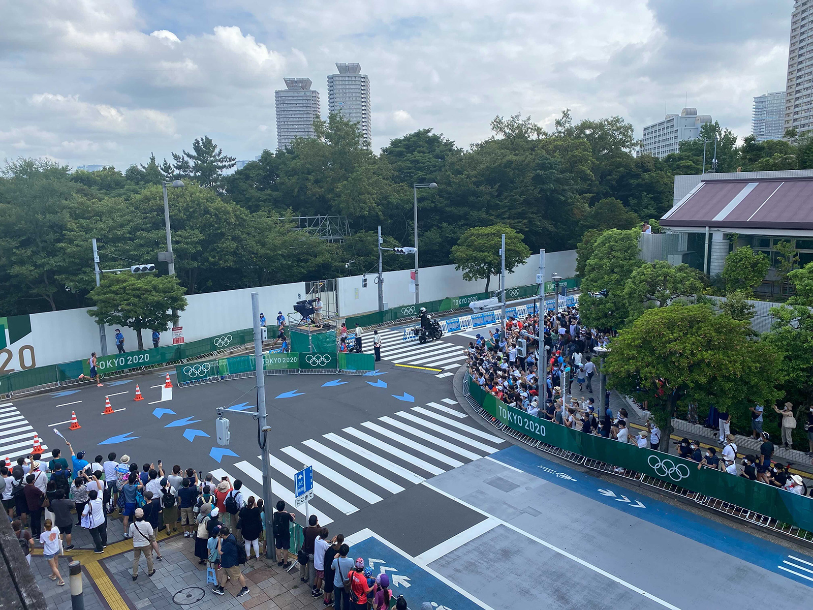 Large crowds of Japanese spectators line the streets to watch the mixed triathlon event early Saturday morning.