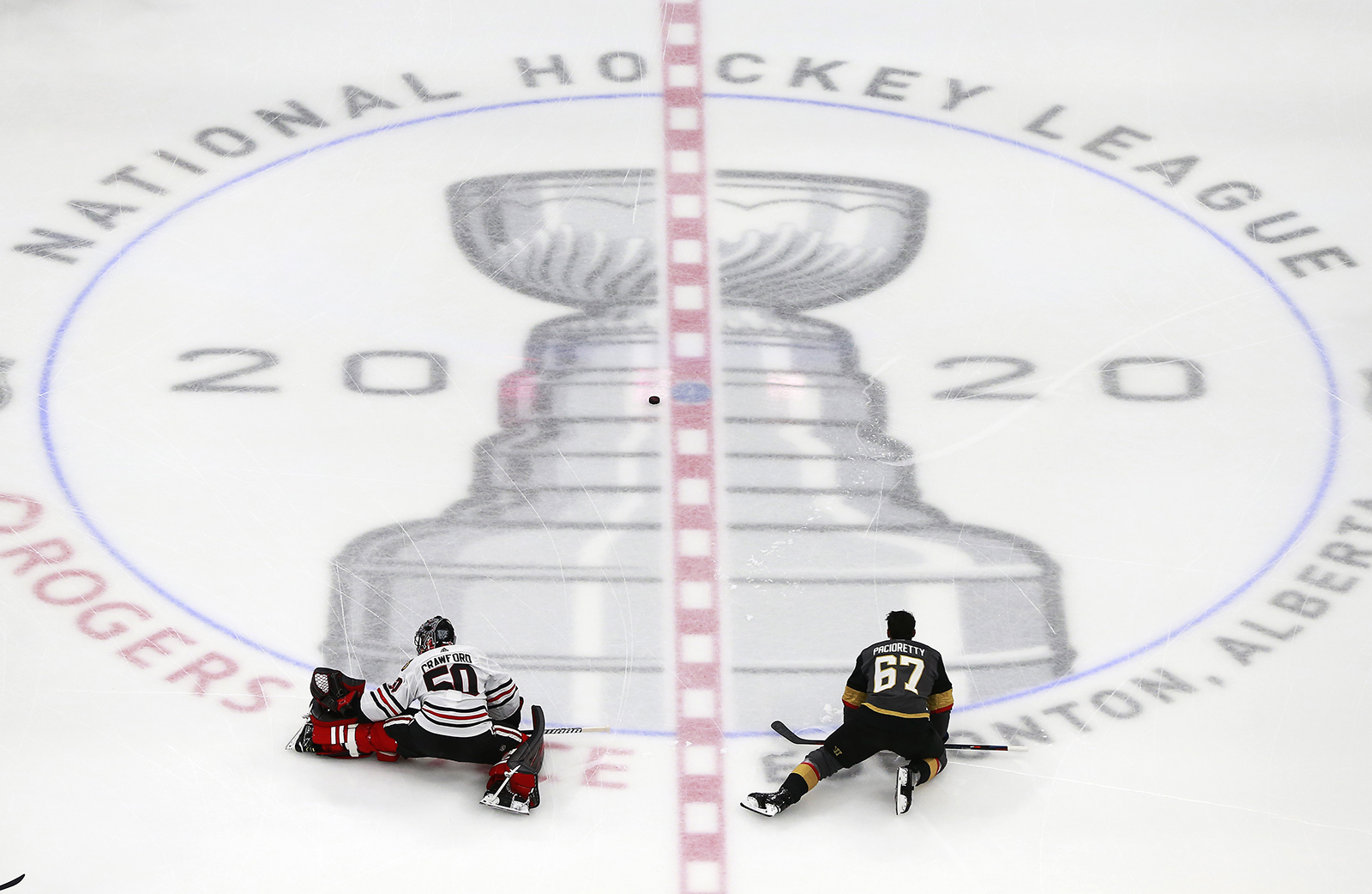 Corey Crawford of the Chicago Blackhawks stretches along with Max Pacioretty of the Vegas Golden Knights before the start of Game One of the Western Conference First Round during the 2020 NHL Stanley Cup Playoffs at Rogers Place on August 11, in Edmonton, Alberta.