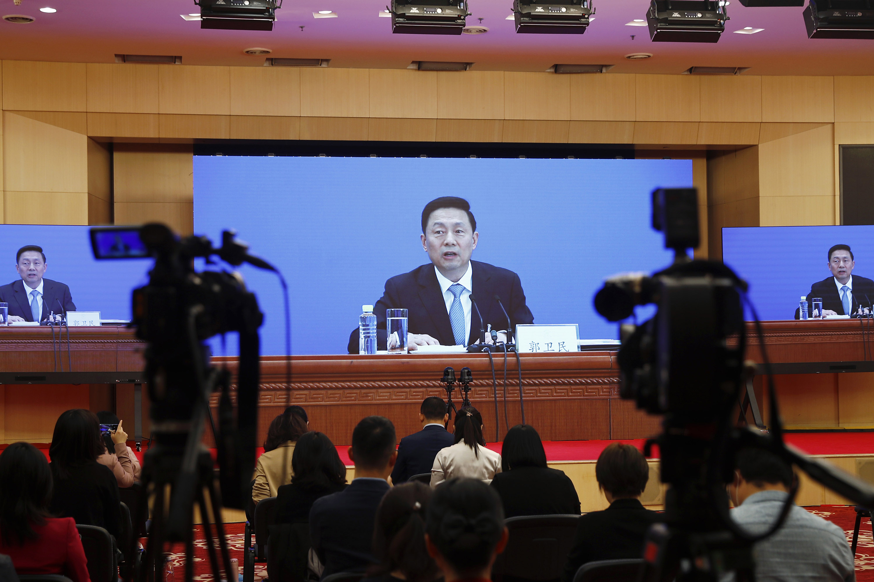 Guo Weimin, spokesman for the National Committee of the Chinese People's Political Consultative Conference (CPPCC), speaks via video at the media center in Beijing, on Wednesday, May 20.