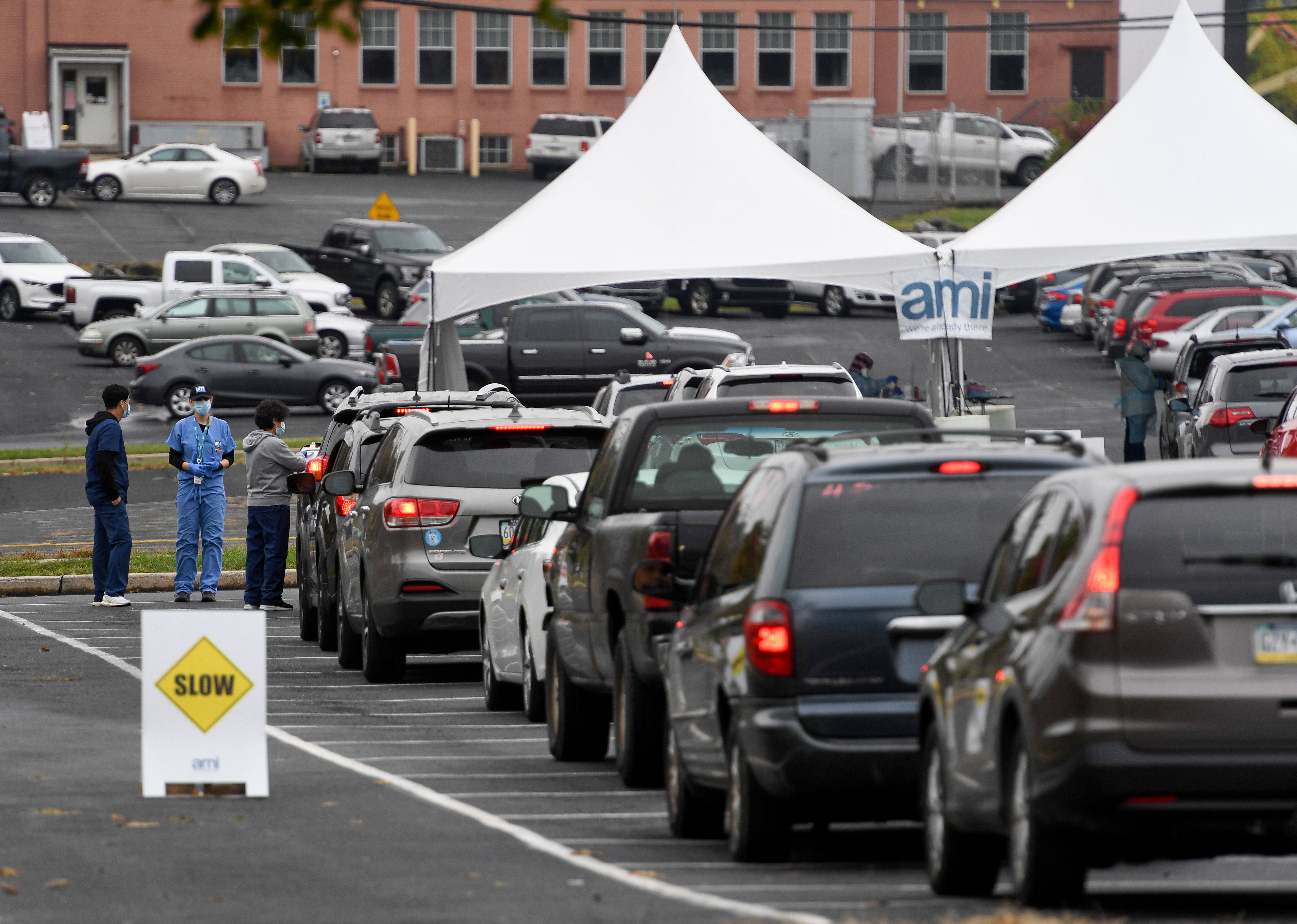 People in cars wait in line for Covid-19 testing on October 13 in Reading, Pennsylvania.