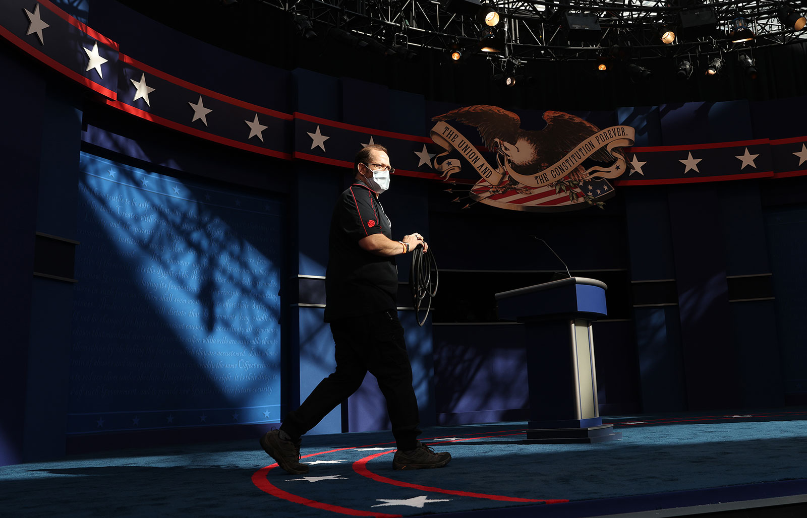Audio technician Dan McNeil participates in a sound check during a rehearsal for the first presidential debate in Cleveland, Ohio,
