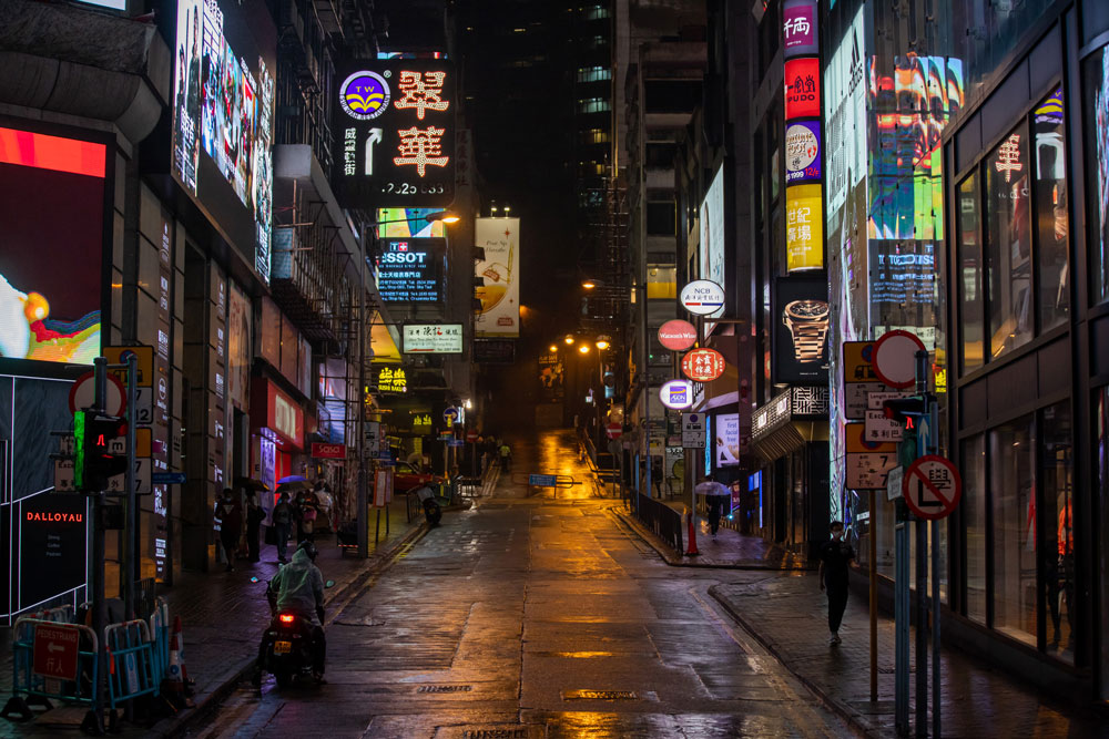 Pedestrians walk along the near-deserted Lan Kwai Fong nightlife area in the Central district of Hong Kong, on Saturday, March 28.