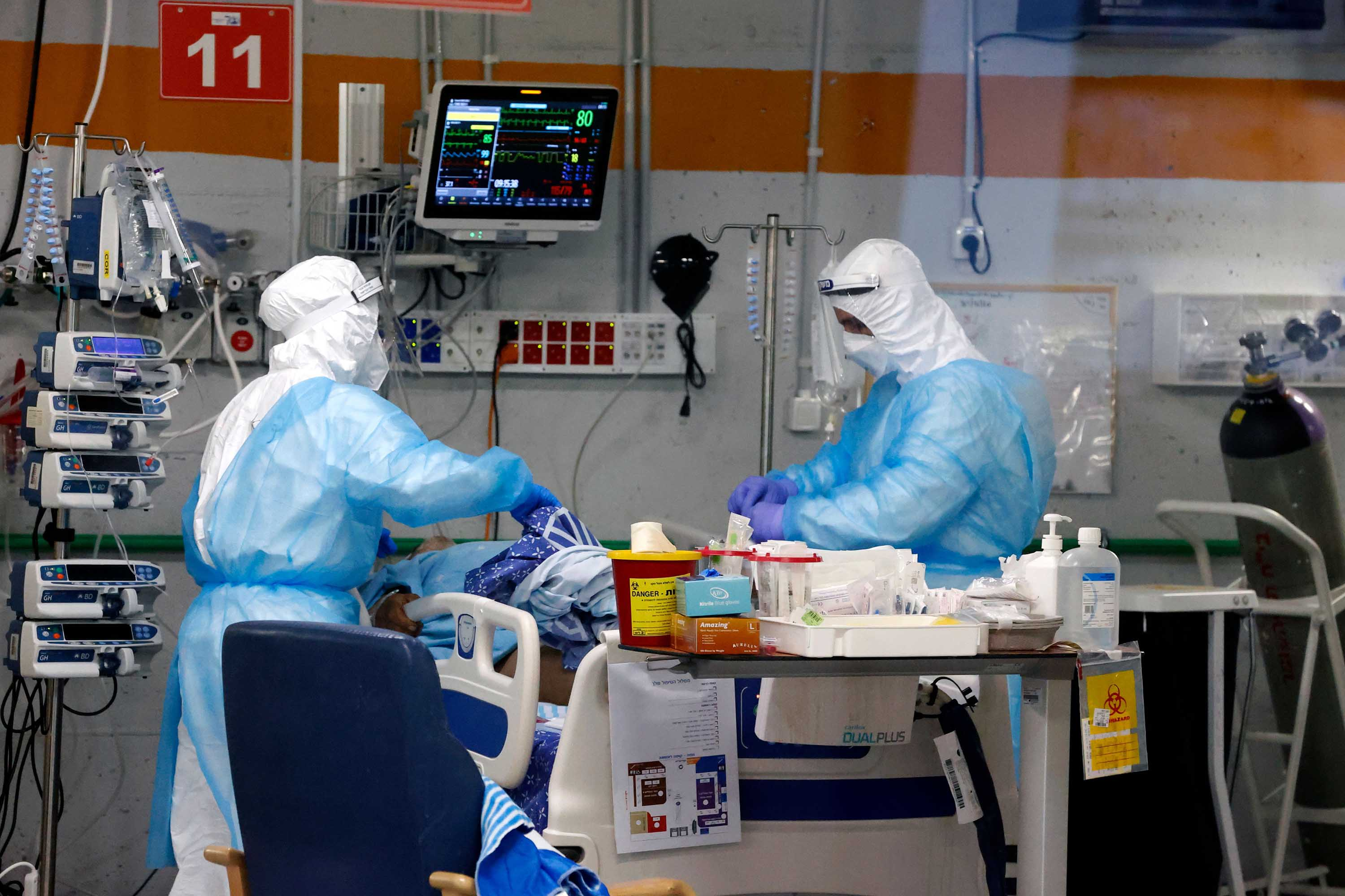 Medics care for a COVID-19 patient at the Sheba Medical Center's isolation ward, in Ramat Gan, Israel, on January 18.
