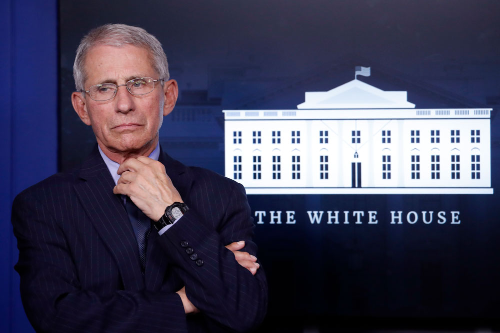 Dr. Anthony Fauci, director of the National Institute of Allergy and Infectious Diseases, listens during a briefing about the coronavirus at the White House on Wednesday, April 1, in Washington.