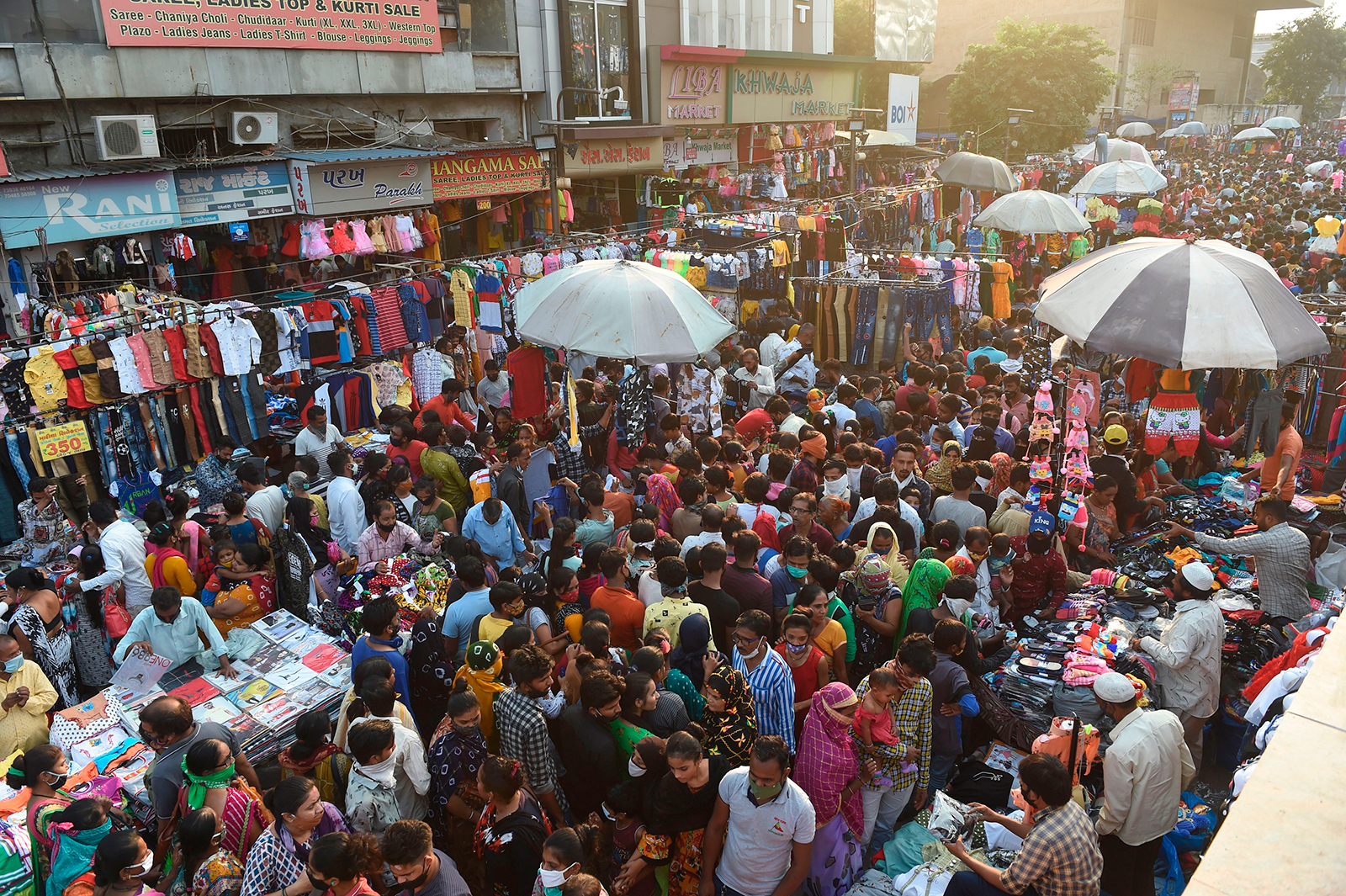 Shoppers throng a market area between Teen Darwaja and Bhadrakali Temple ahead of Diwali, the Hindu Festival of Lights, amid the Covid-19 coronavirus pandemic in Ahmedabad, India, on November 8.