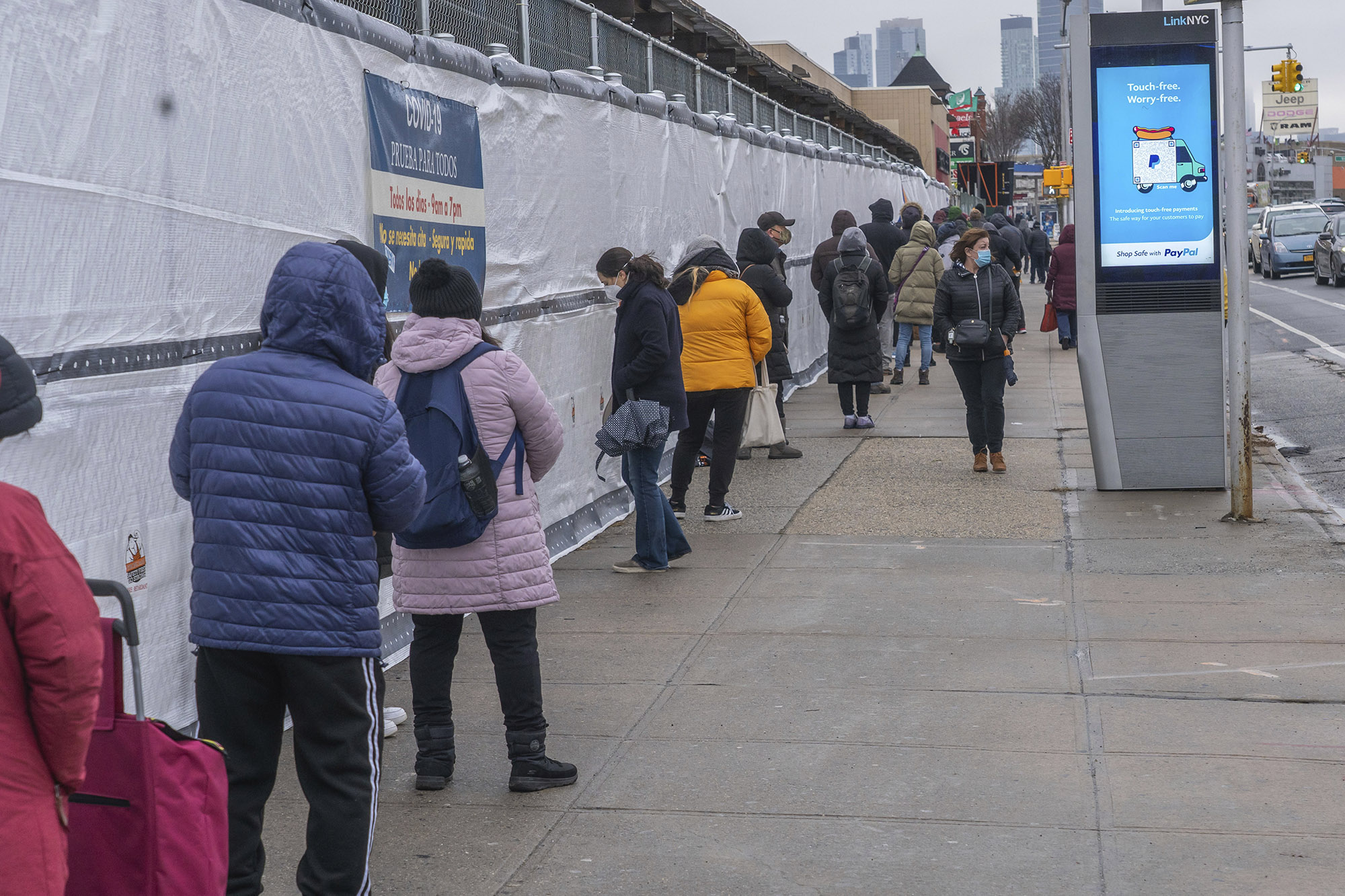 New York City residents wait in a line outside a COVID-19 testing site through NYC Health + Hospitals located in Queens, on Sunday, January 3.