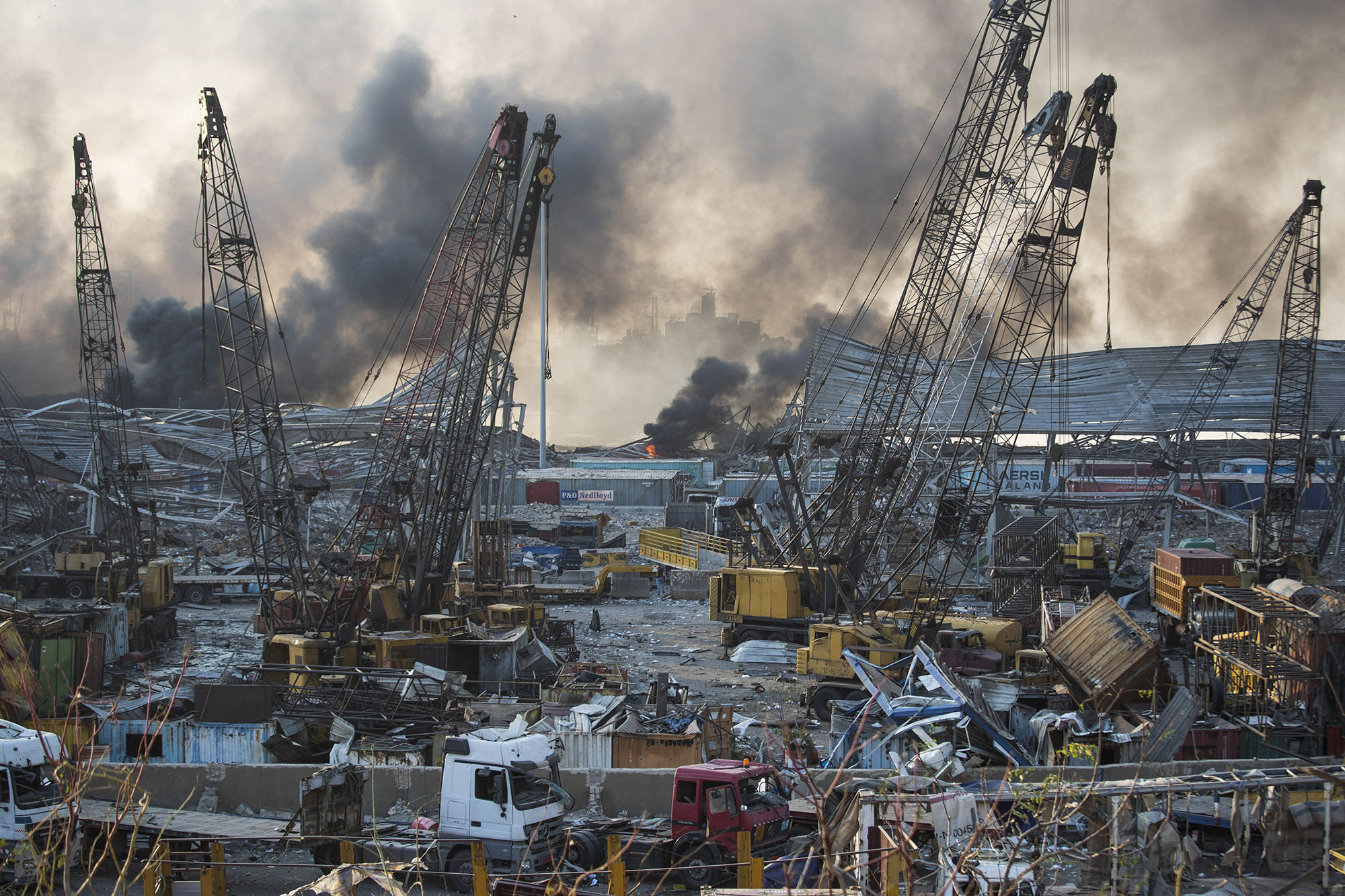Smoke rises in the aftermath of a massive explosion in Beirut, Lebanon, on Tuesday, August 4.