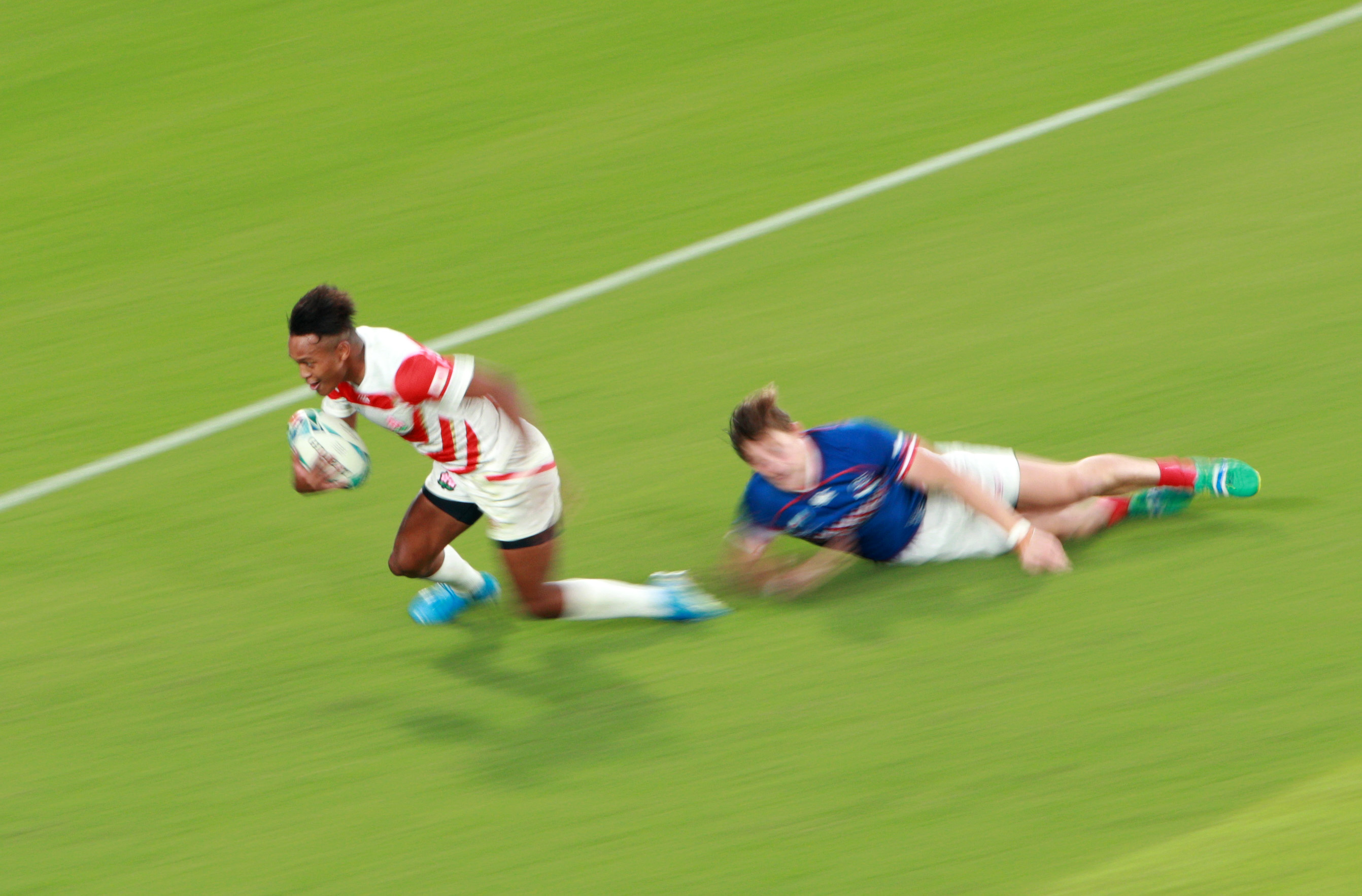 Kotaro Matsushima scores his third try of the match against Russia.