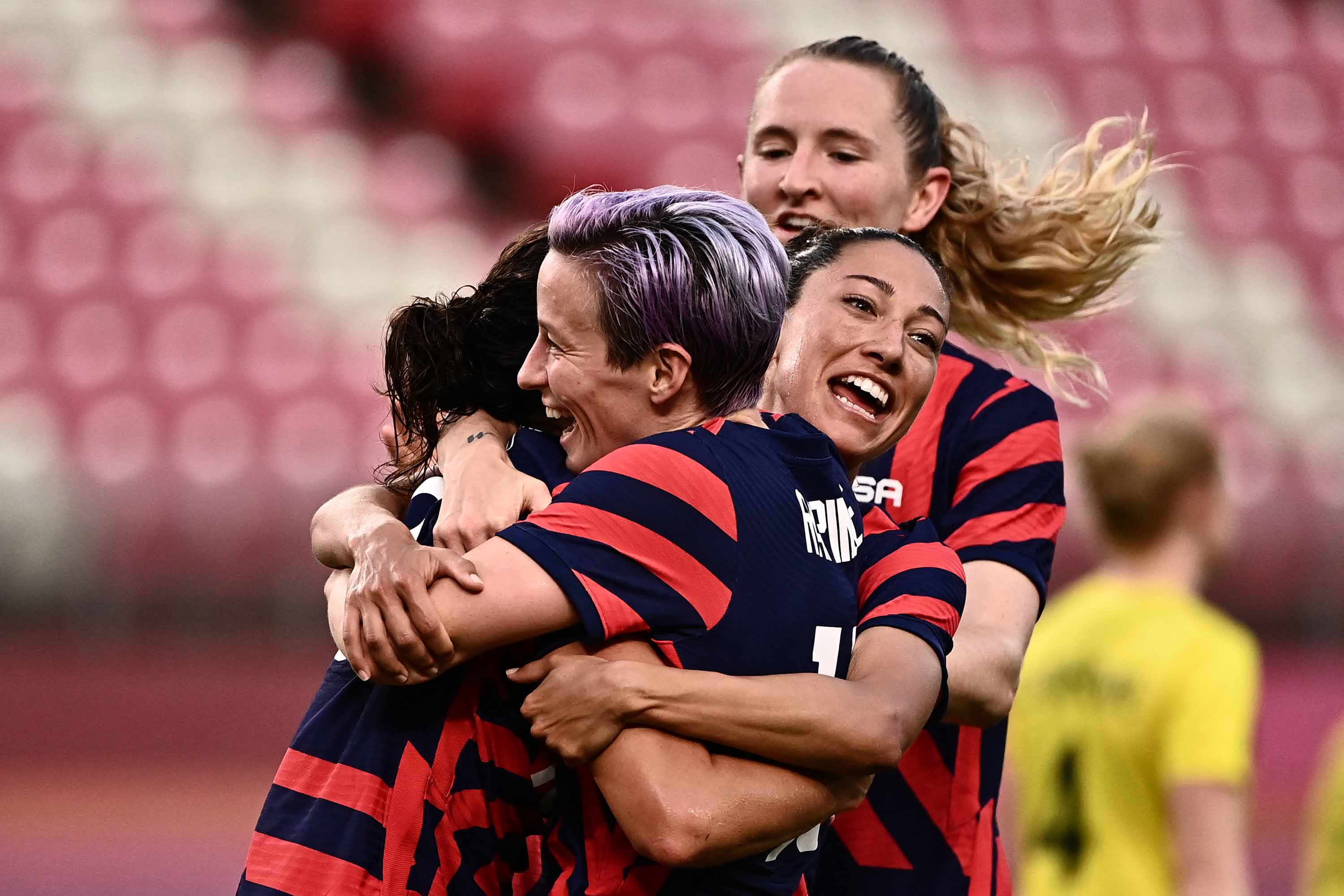USA's forward Carli Lloyd, left, is congratulated by teammates after scoring during the women's bronze medal football match between Australia and the United States on August 5.