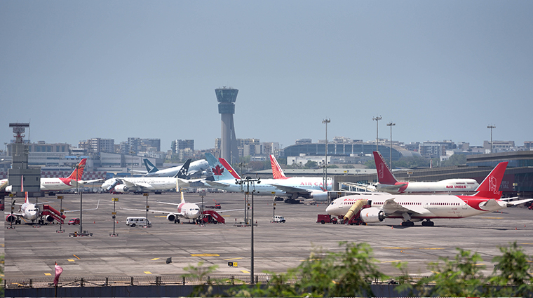 Planes are seen parked at Mumbai airport, on  Saturday, March 21, in Mumbai, India.