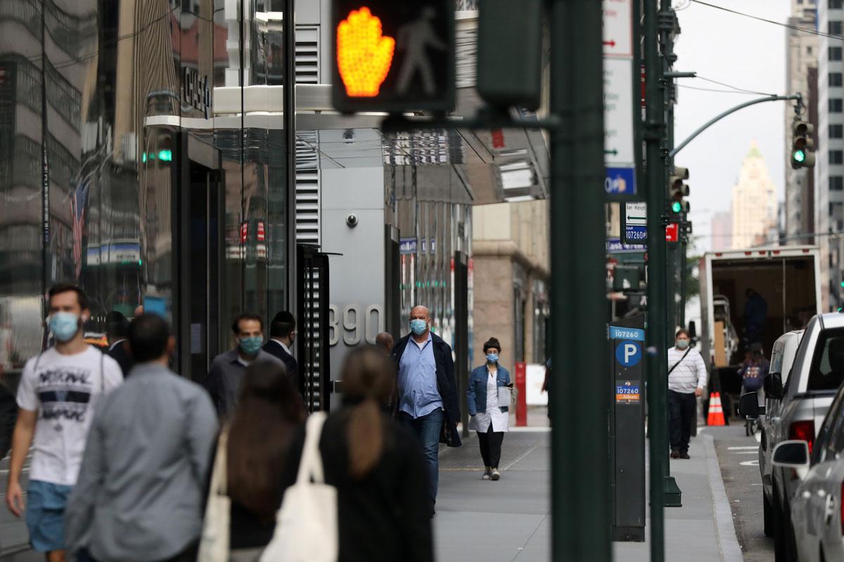 People walk through Manhattan, New York on October 21.
