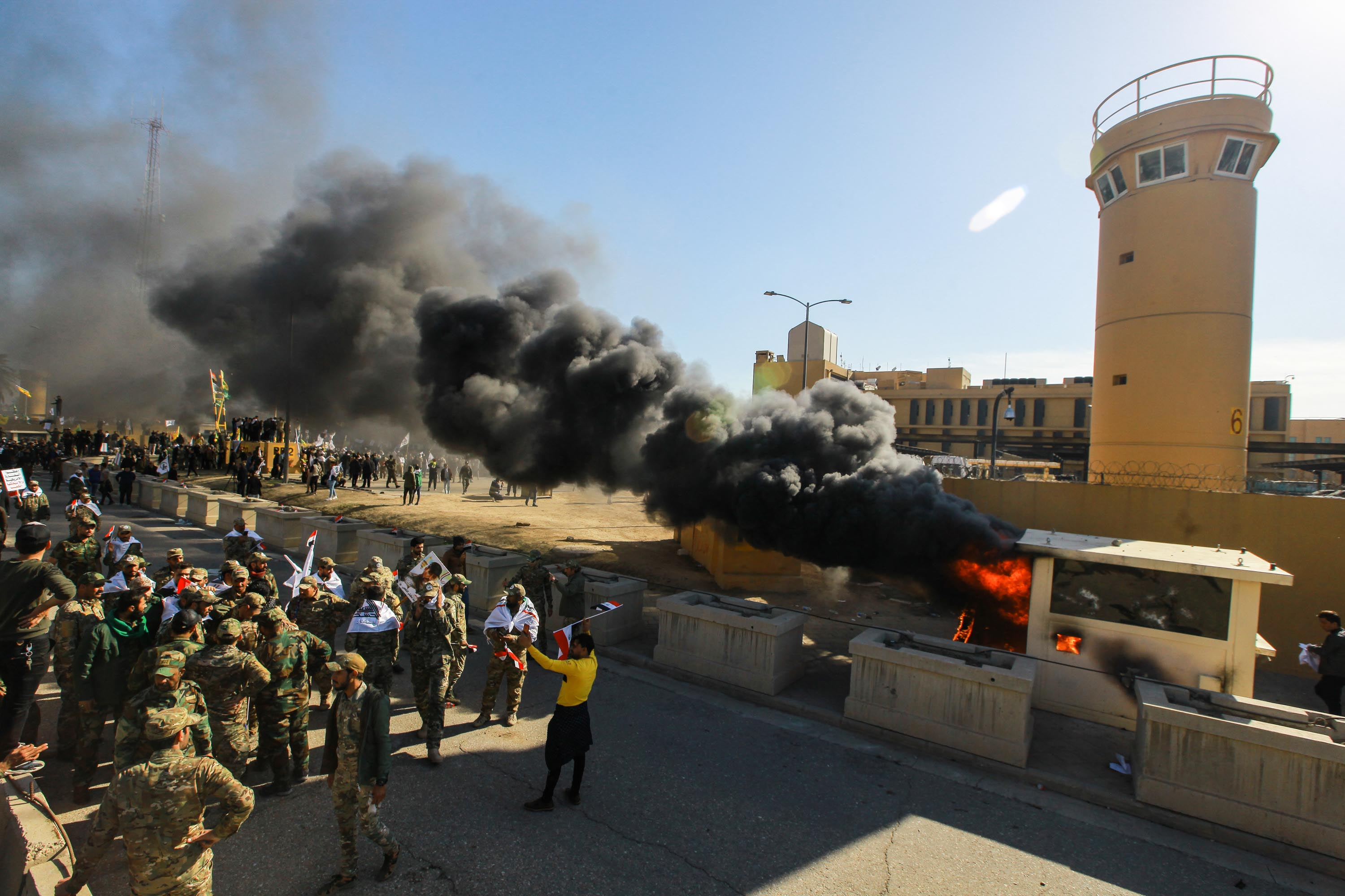 Protesters set a sentry box ablaze in front of the US embassy building in the Iraqi capital, Baghdad.