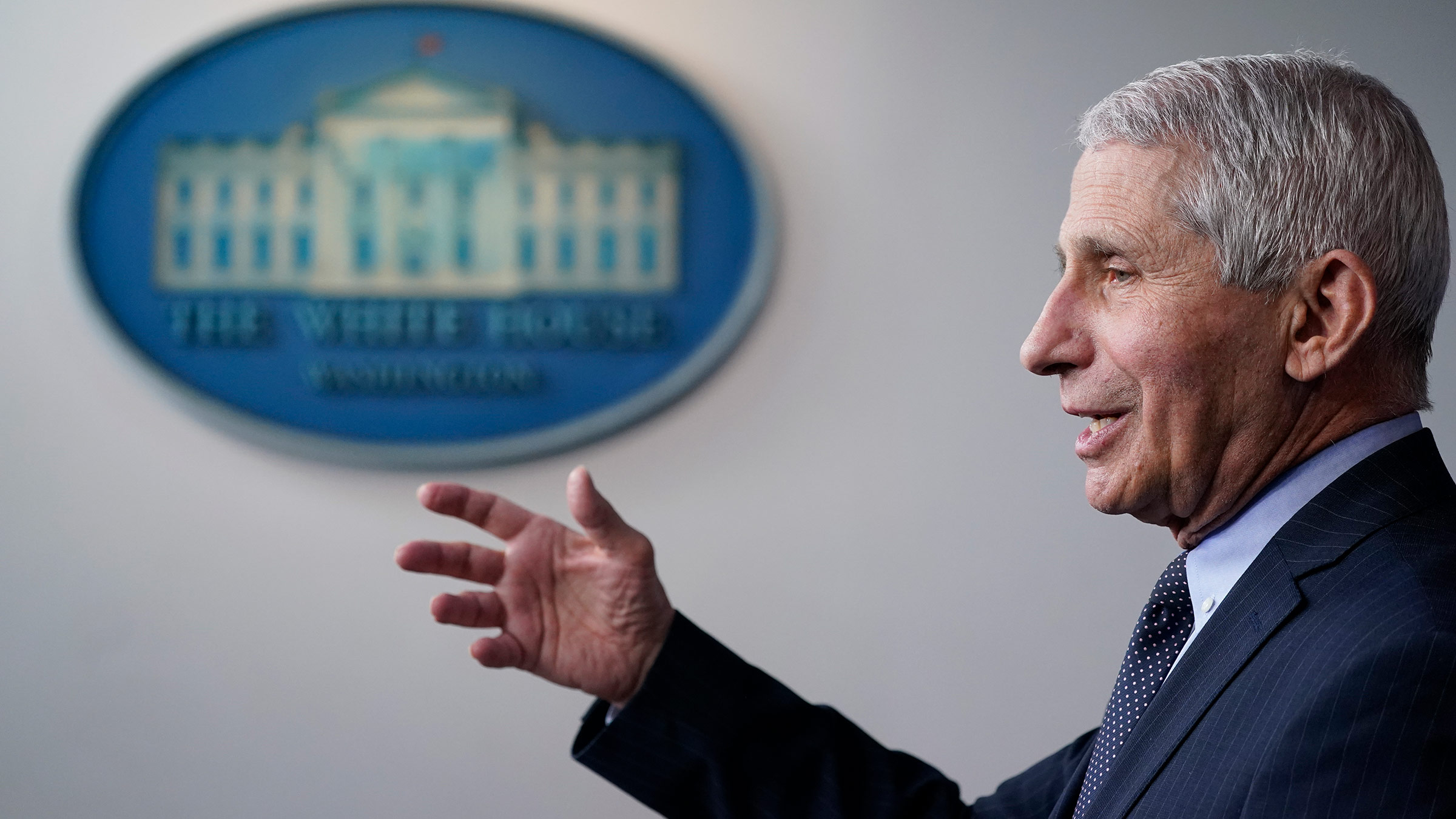Dr. Anthony Fauci speaks with reporters at the White House on Thursday, January 21, in Washington, DC.