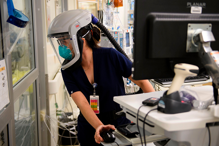A nurse looks through a door into a patients room in a Covid-19 intensive care unit at Martin Luther King Jr. Community Hospital on January 6, in the Willowbrook neighborhood of Los Angeles, California.