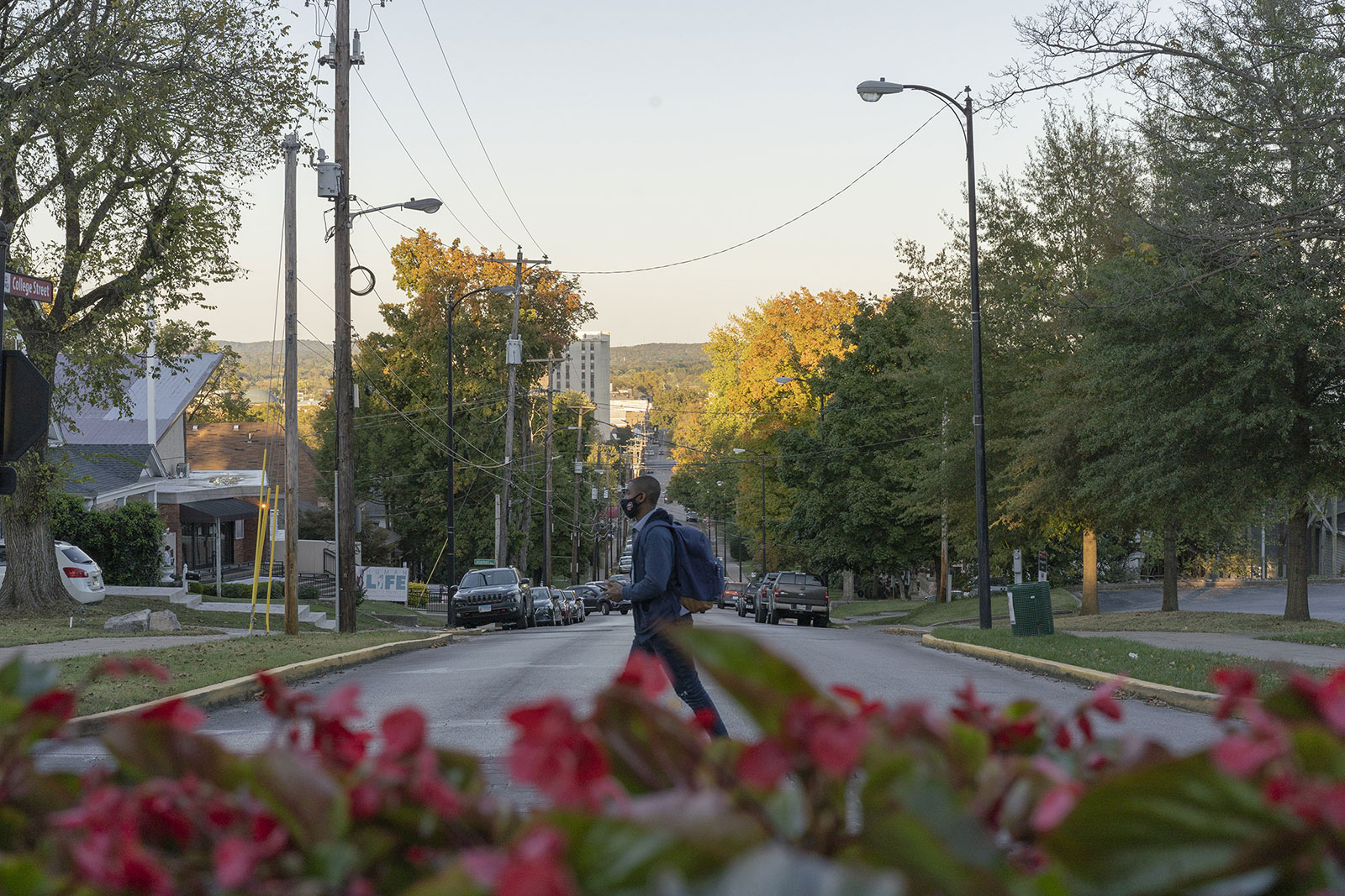 A person wearing a mask crosses the street in Bowling Green, Kentucky, on October 16.