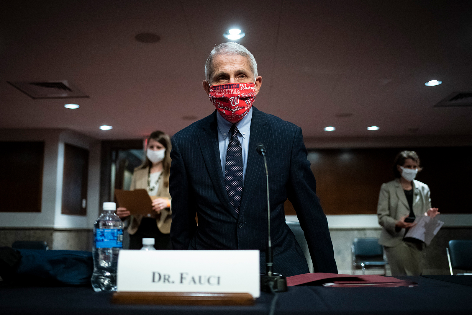 Dr. Anthony Fauci, director of the National Institute of Allergy and Infectious Diseases, wears a Washington Nationals protective mask while arriving to a Senate Health, Education, Labor and Pensions Committee hearing on June 30 in Washington.