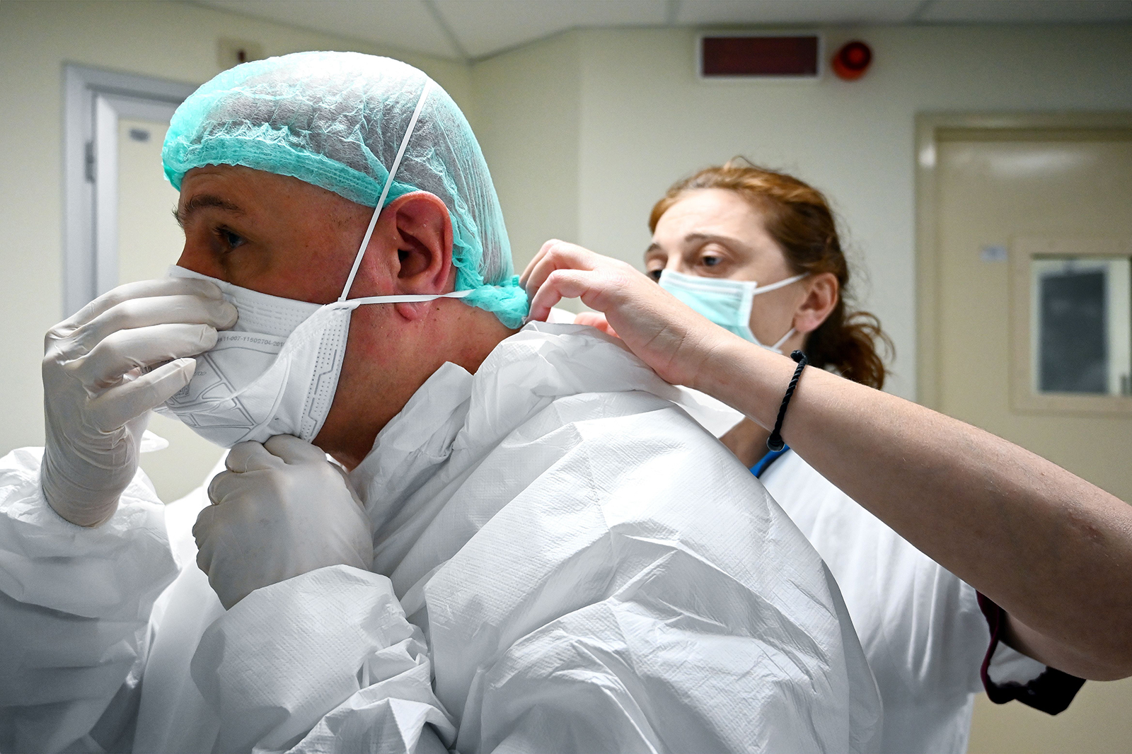 A nurse helps Italian anaesthesiologist Marino De Rosa to put on his mask at the ICU division of the Covid-19 unit at the San Filippo Neri hospital, in Rome, on April 29.