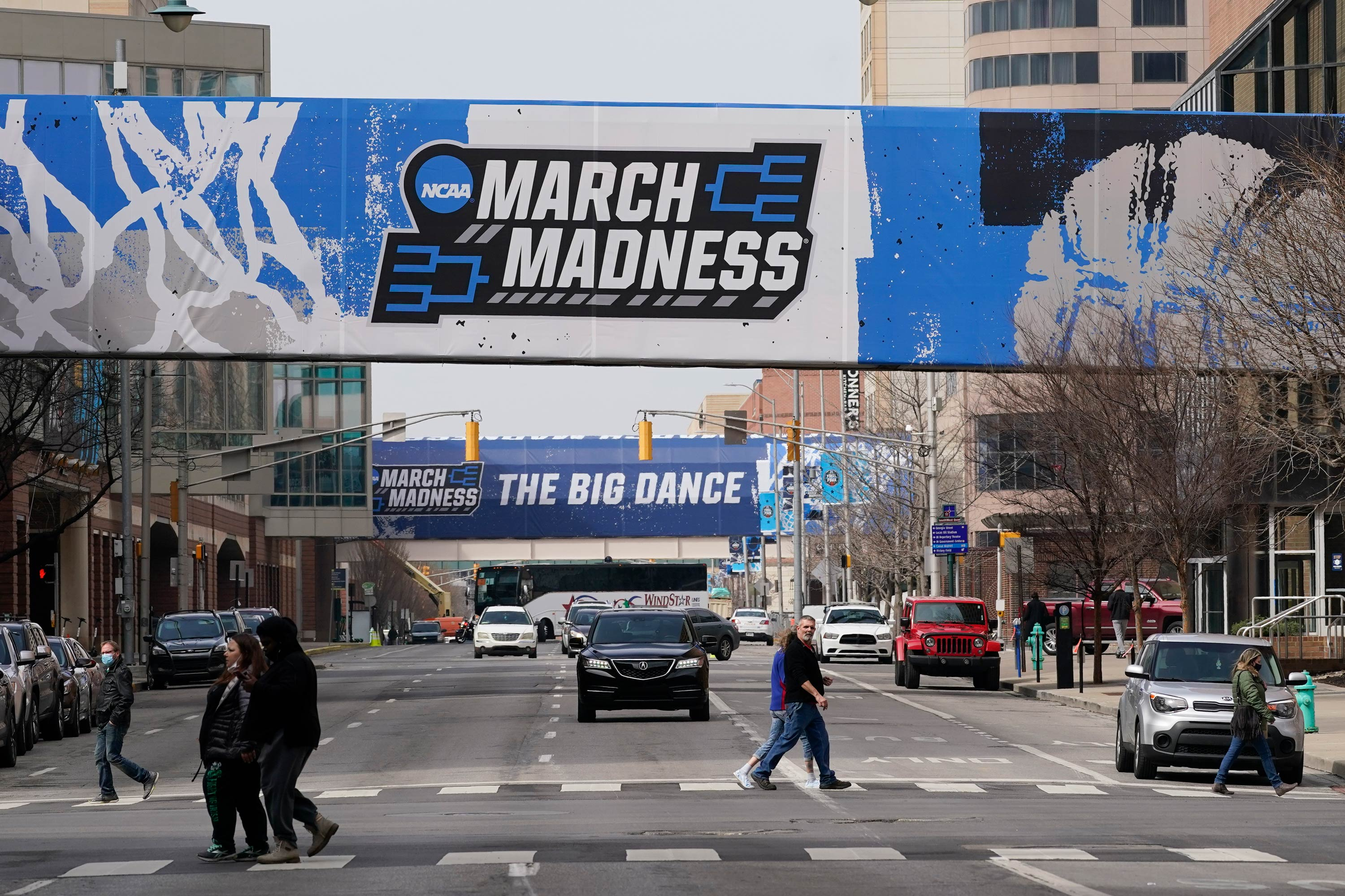 March Madness banners for the NCAA college basketball tournament cover crosswalks in downtown Indianapolis on March 17.