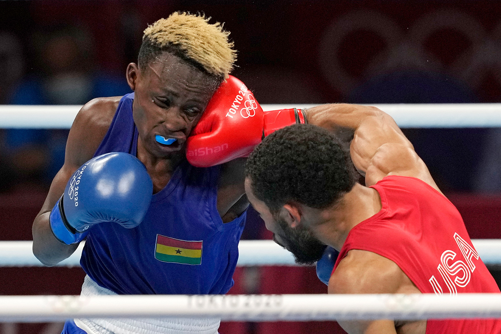 The United States' Duke Ragan, right, exchanges punches with Ghana's Samuel Takyi during their men's featherweight 57-kg semifinal boxing match on Tuesday.
