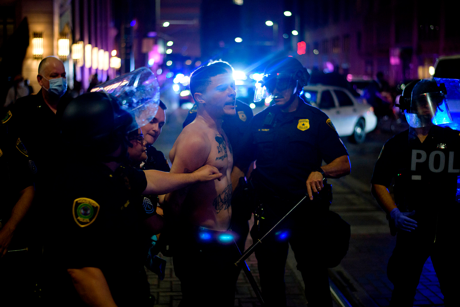 A protester is detained by police in Houston, on May 29.