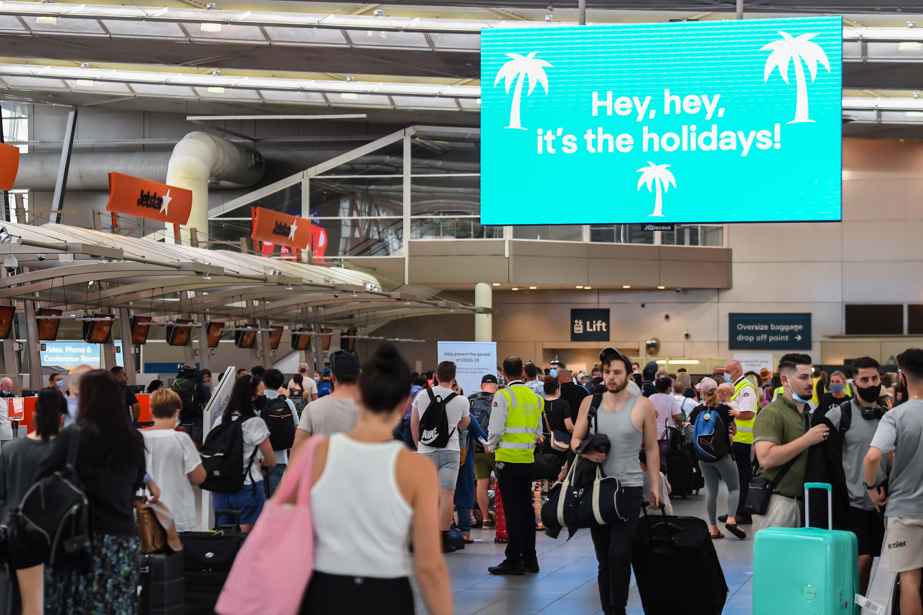 Travelers are seen at Sydney's Kingsford Smith domestic airport on December 18, in Sydney, Australia.