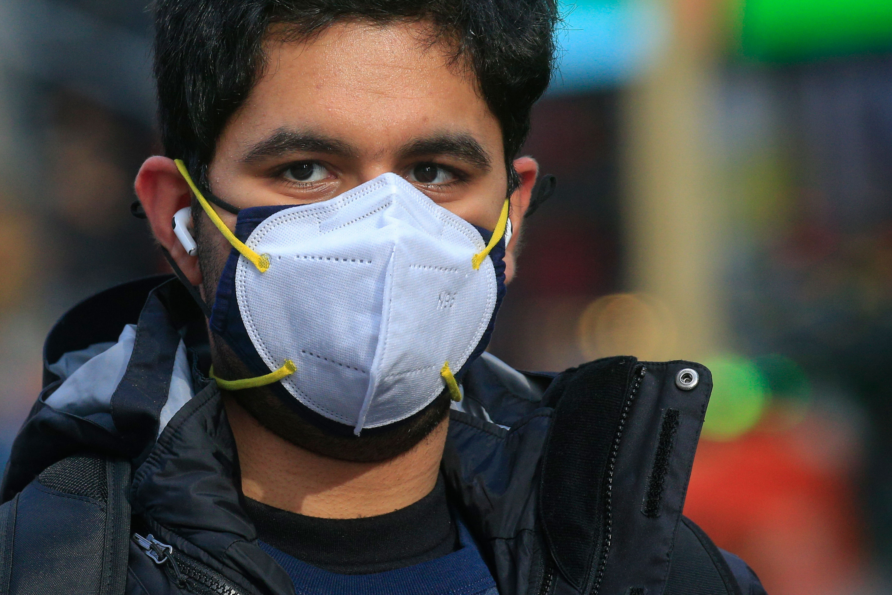 A man wears two masks as he visits Times Square in New York on December 10.