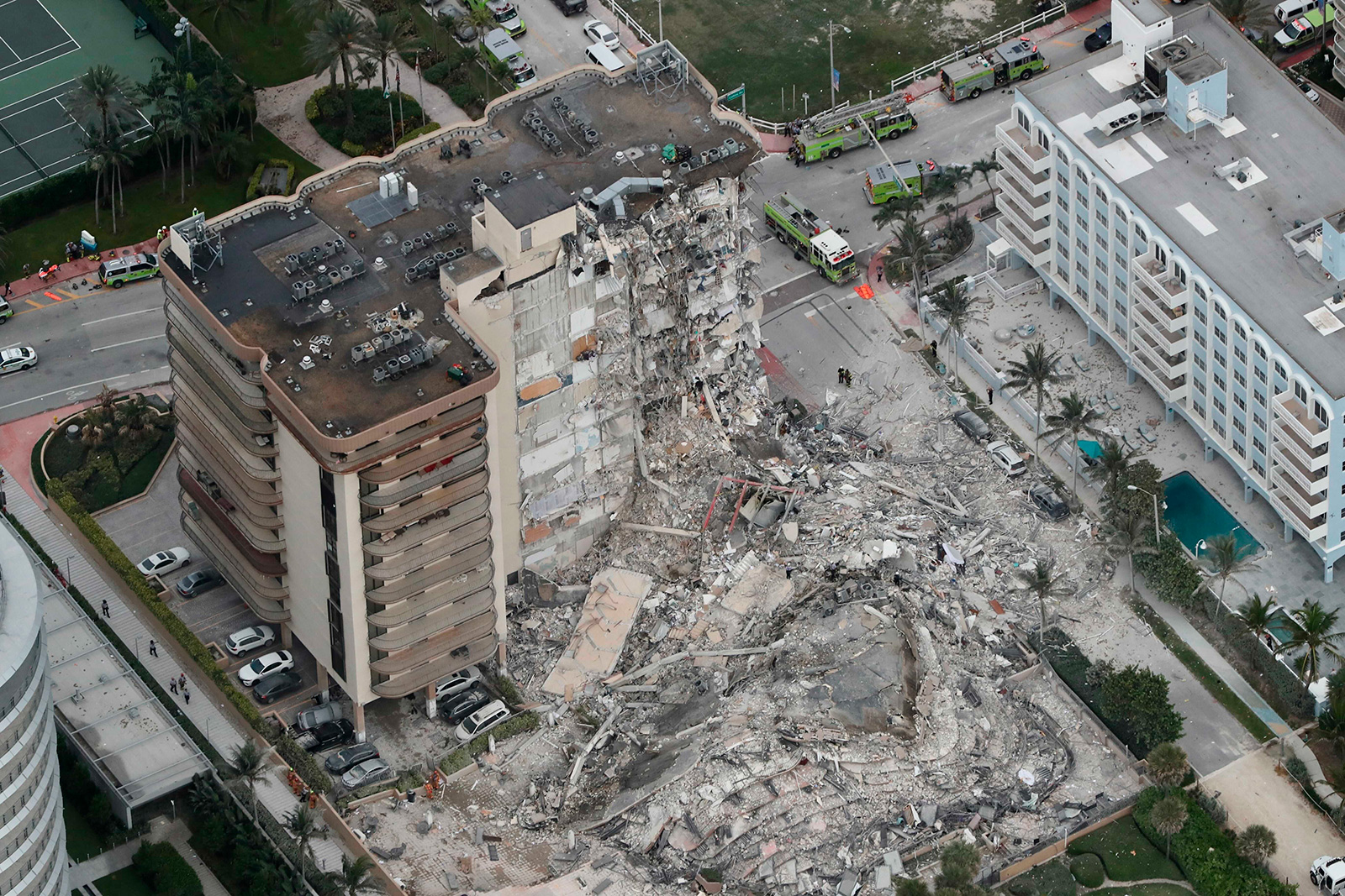 This aerial photo shows part of the 12-story oceanfront Champlain Towers South Condo that collapsed early Thursday, June 24, in Surfside, Florida.