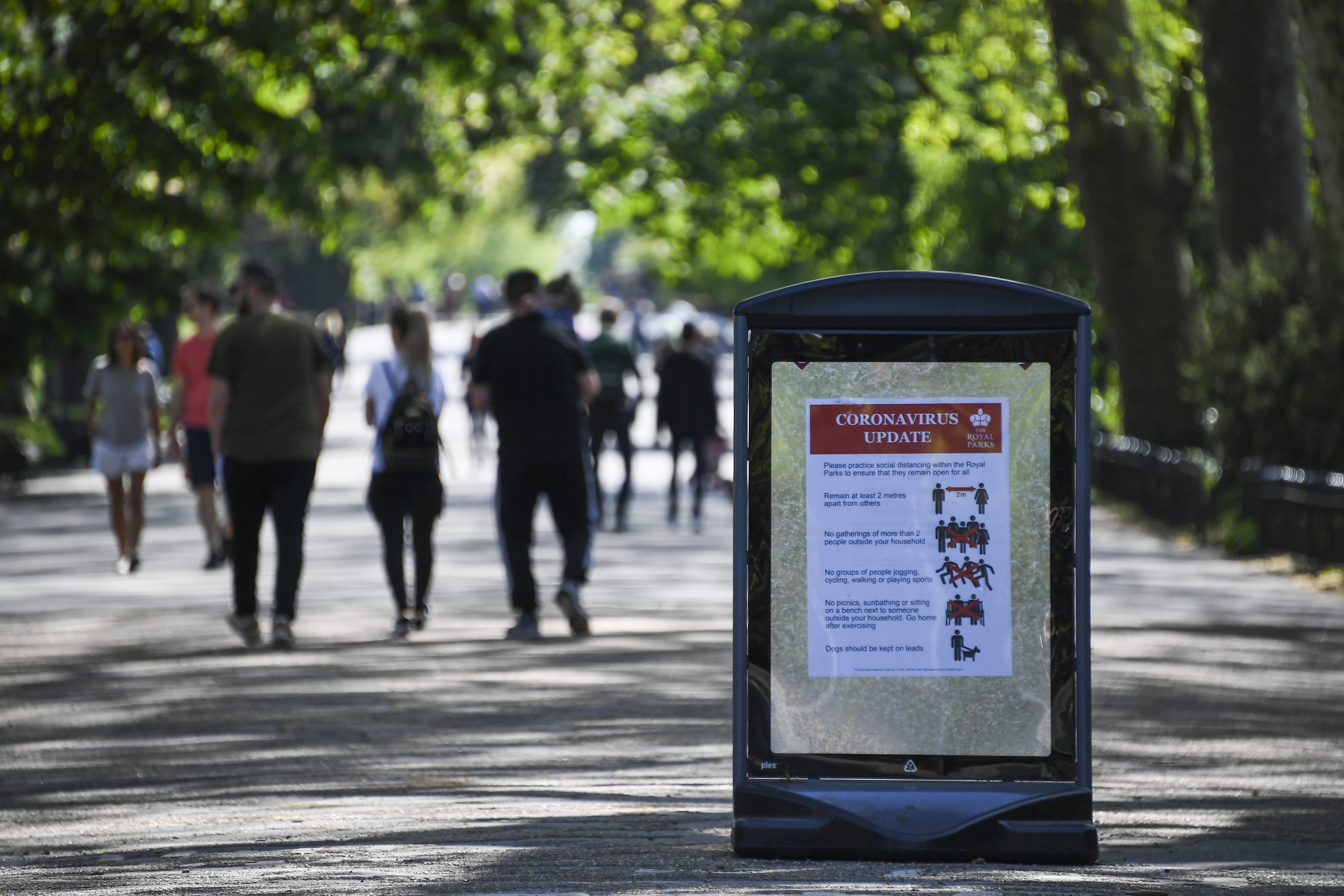 A social distancing sign is seen at the entrance of Regent's Park in London on April 26.