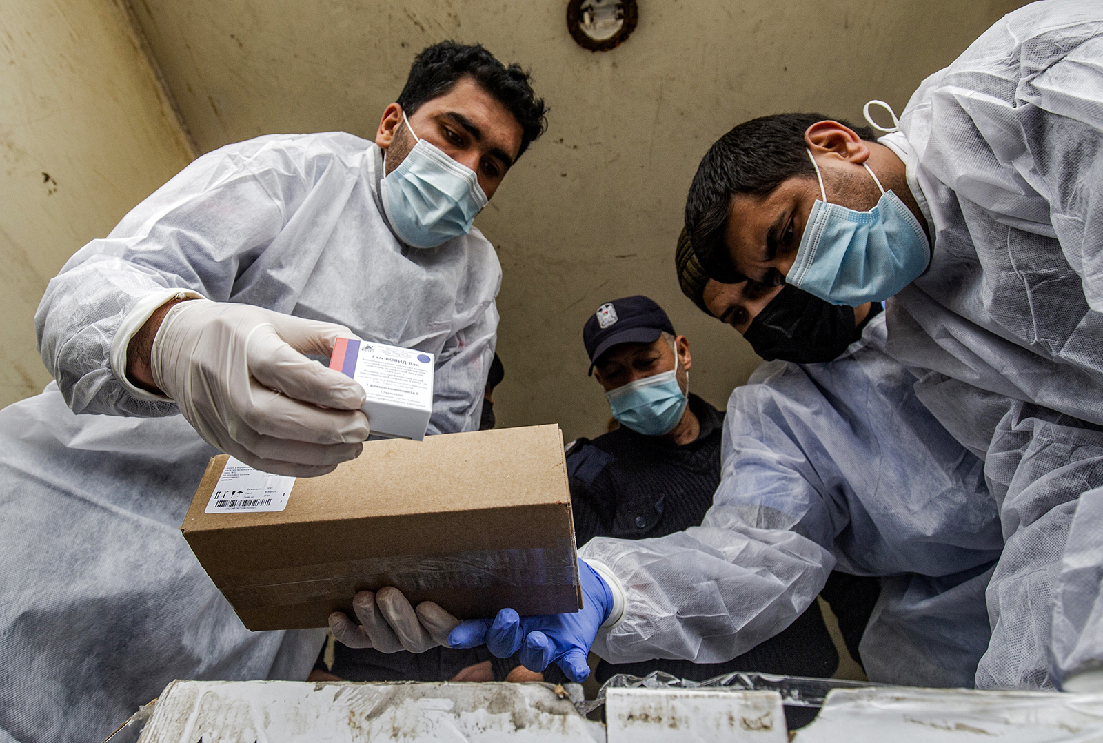 Health workers unload the first shipment of Russia's Sputnik V Covid-19 vaccine in Gaza on February 17.