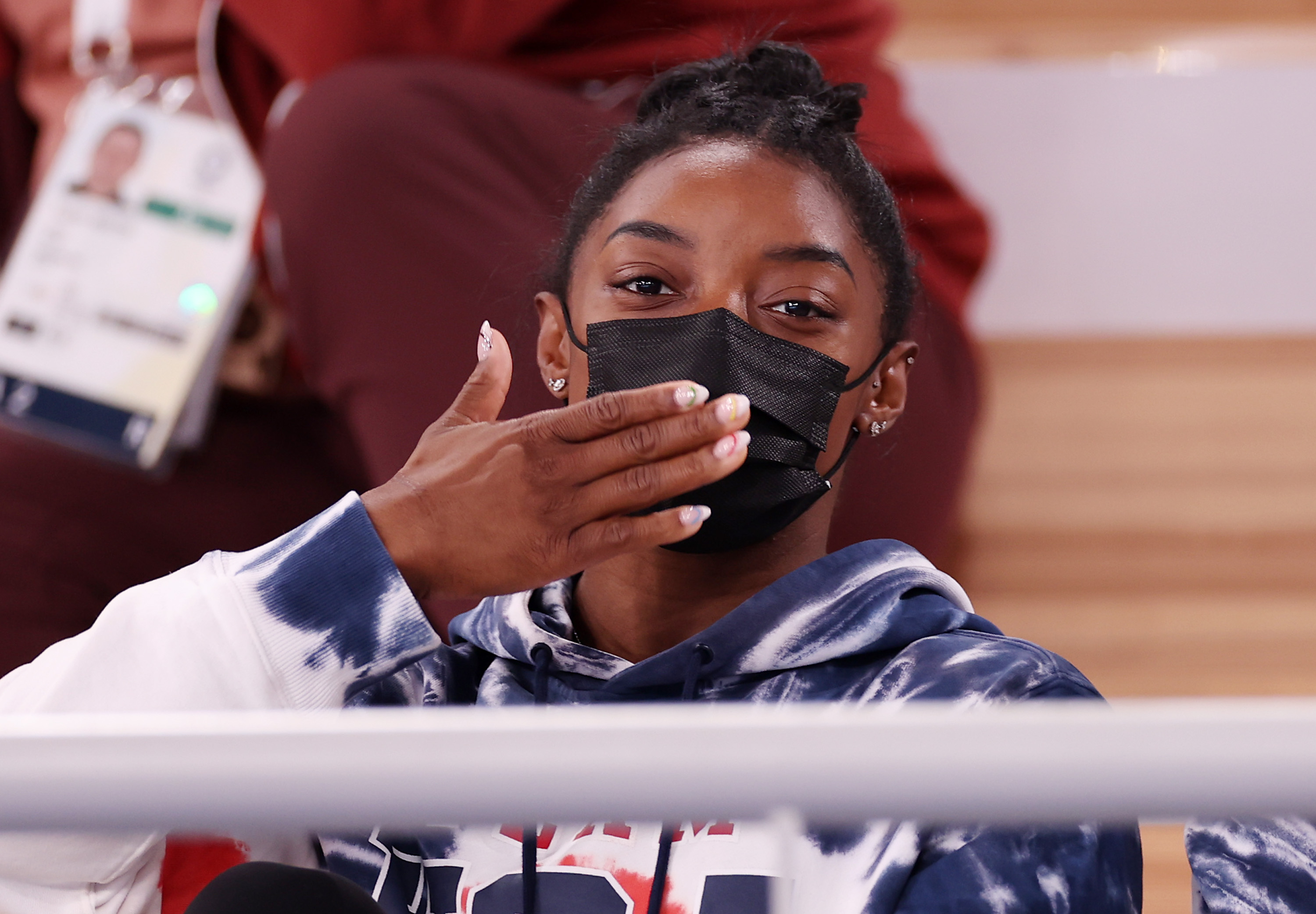 Simone Biles blows a kiss while watching the men's All-Around Final on day five of the Tokyo 2020 Olympic Games at Ariake Gymnastics Centre on July 28, 2021 in Tokyo, Japan.