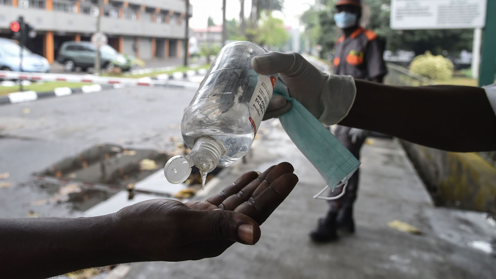 A visitor sanitizes their hands before being allowed into a state hospital at Yaba in Lagos, Nigeria on February 28.