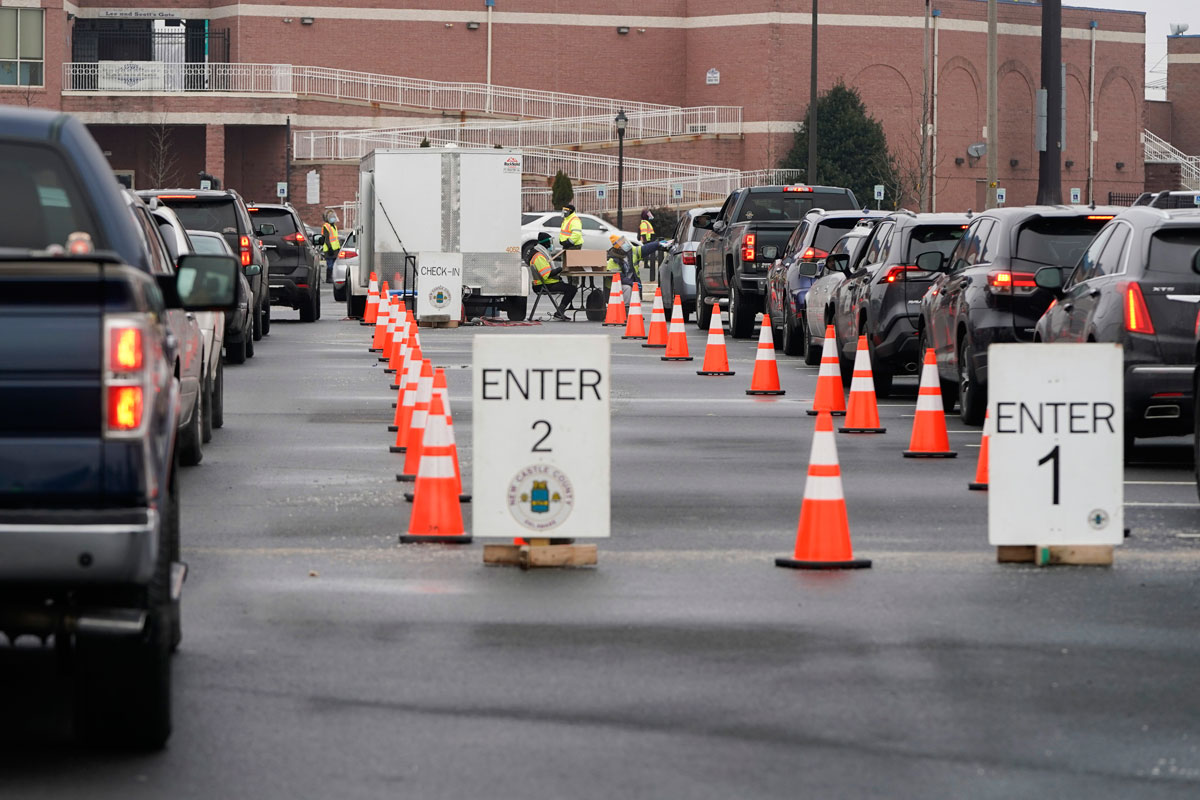 Residents get tested for Covid-19 in a Wilmington, Delaware drive-thru testing facility on December 21.