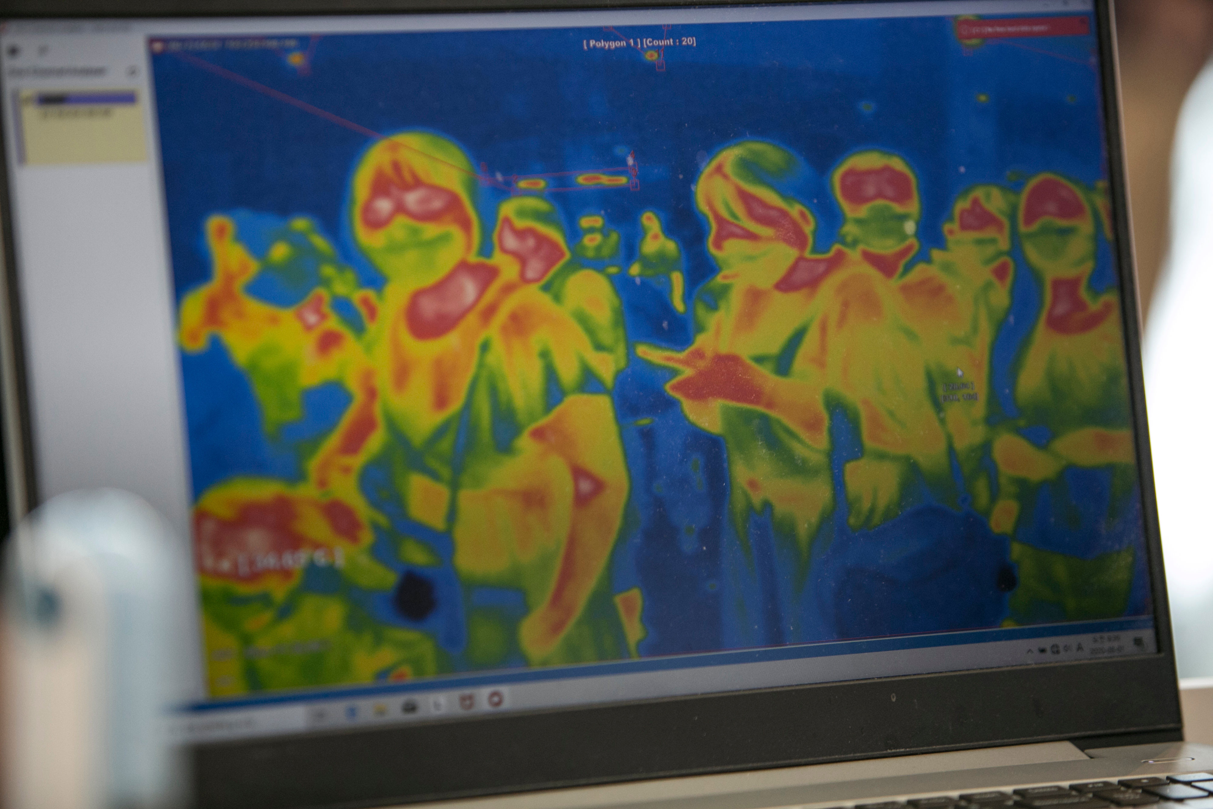 A thermographic image of passengers is displayed on a screen at Gimpo International Airport in Seoul, South Korea, on August 1.